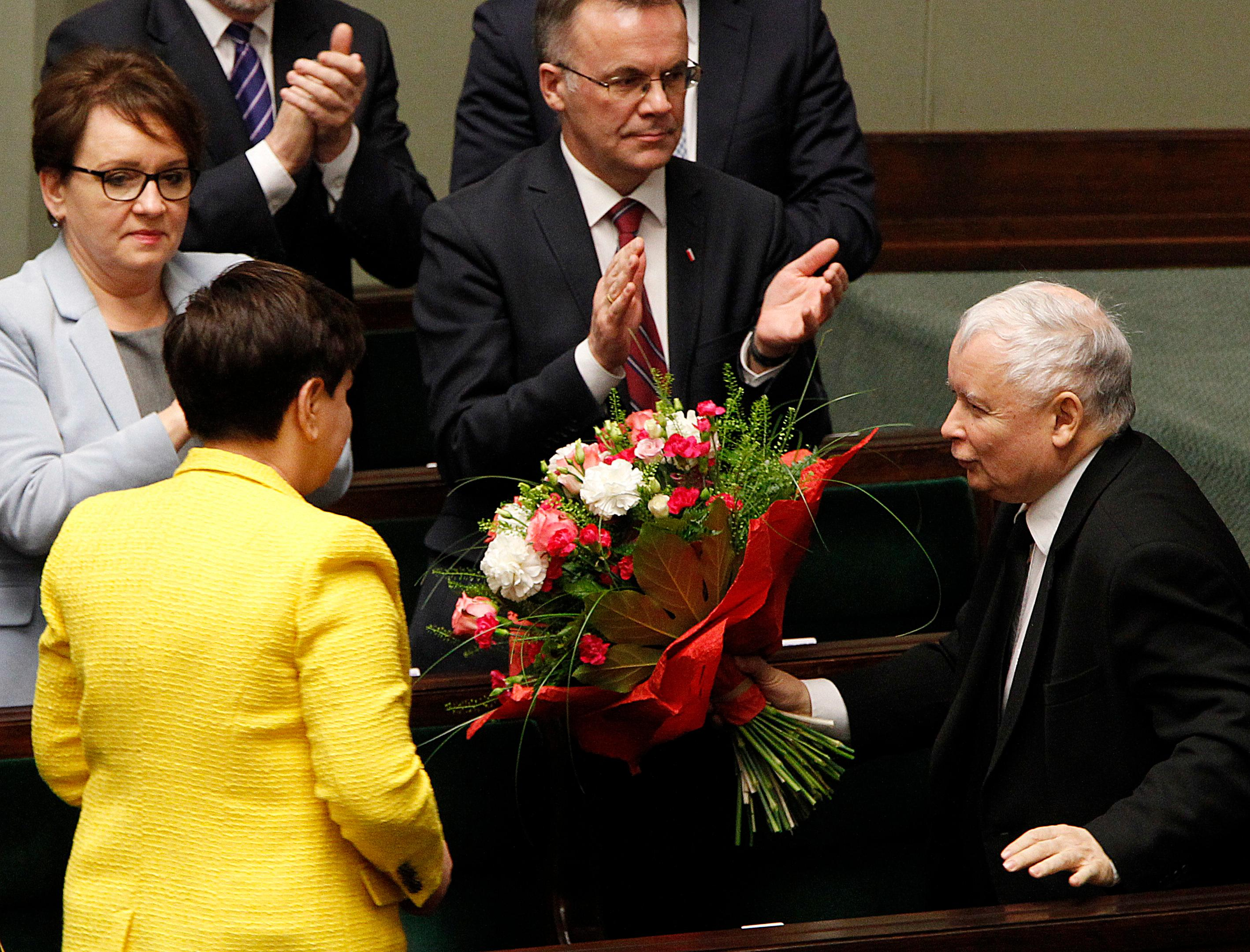 Jaroslaw Kaczynski, the powerful leader of Poland's ruling Law and Justice party congratulates Prime Minister Beata Szydlo after her government survived a vote in which the opposition was seeking to oust it, at the parliament buildingin Warsaw, Poland, Thursday, Dec. 7, 2017. (AP Photo/Czarek Sokolowski)