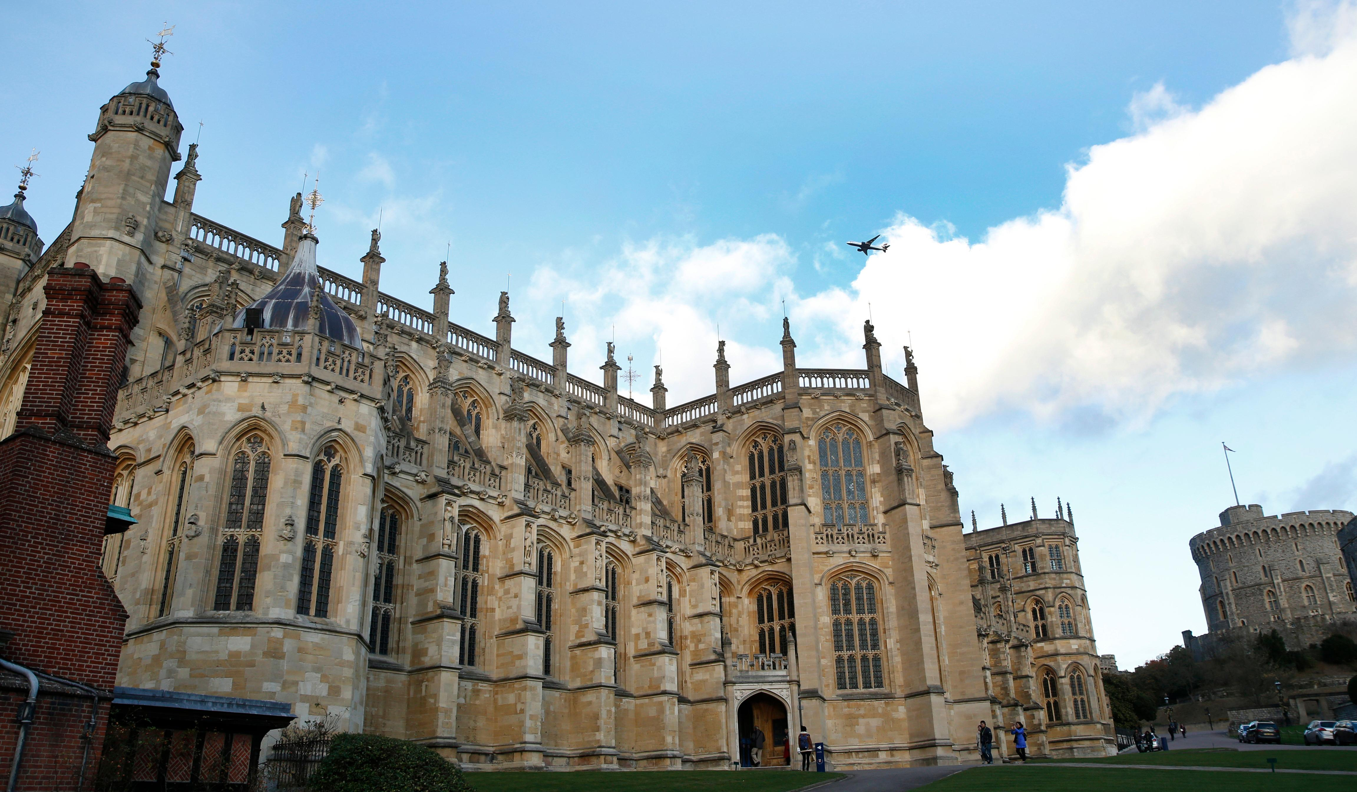 FILE - This Tuesday, Nov. 28, 2017 file photo shows a general view of St George's Chapel within the walls of of Windsor Castle, in Windsor, England. Prince Harry and his fiancee, American actress Meghan Markle, have released more details about their May 19 wedding, revealing that the event will include a carriage ride through Windsor so they can share the big day with the public. The couple will marry at noon in St George's Chapel, the 15th-Century church on the grounds of Windsor Castle that has long been the backdrop of choice for royal occasions. Harry's grandmother, Queen Elizabeth II, gave permission for use of the venue and will attend the wedding. (AP Photo/Alastair Grant, File)