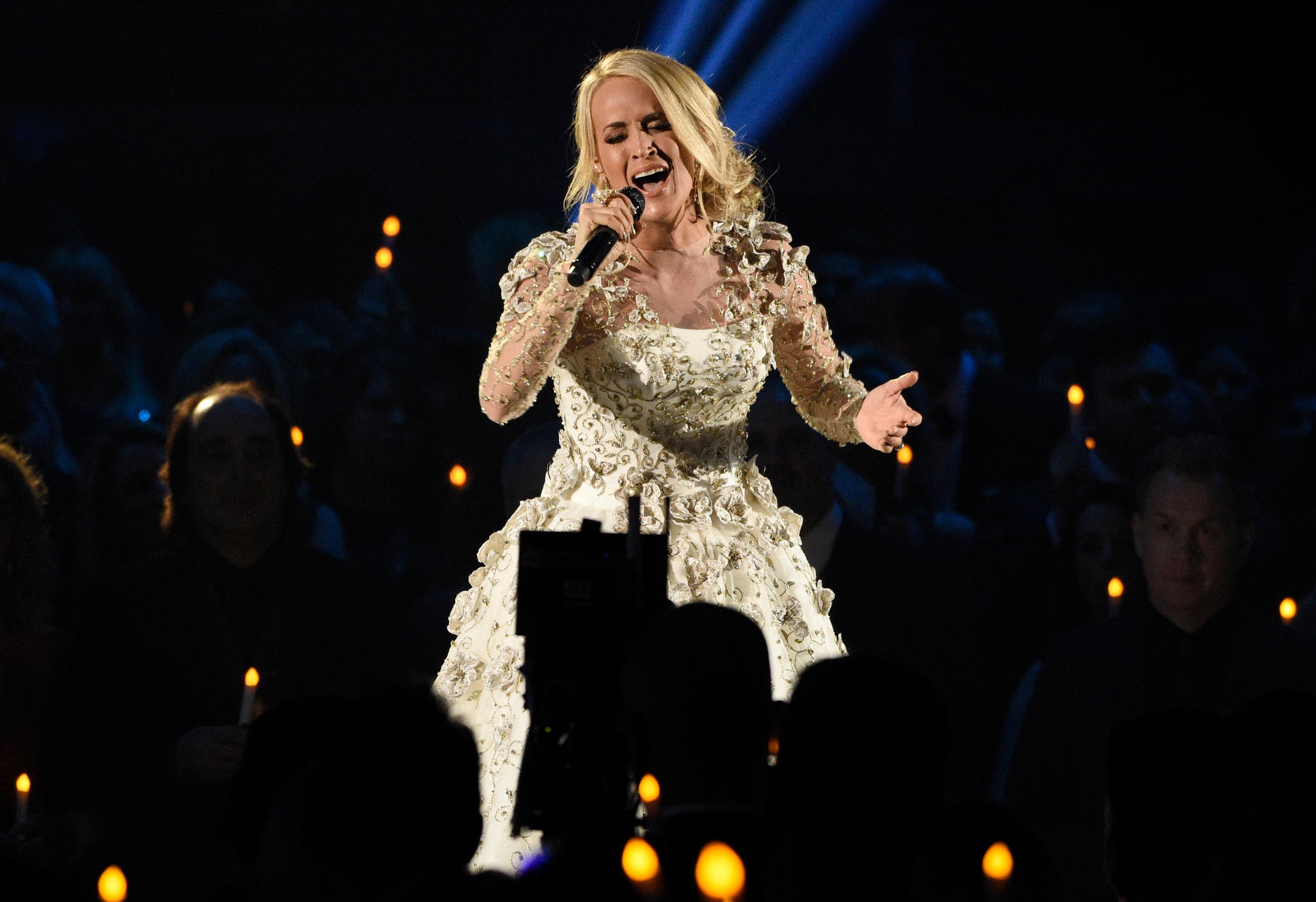 "Carrie Underwood performs ""Softly and Tenderly"" during an In Memoriam tribute at the 51st annual CMA Awards at the Bridgestone Arena on Wednesday, Nov. 8, 2017, in Nashville, Tenn. (Photo by Chris Pizzello/Invision/AP)"