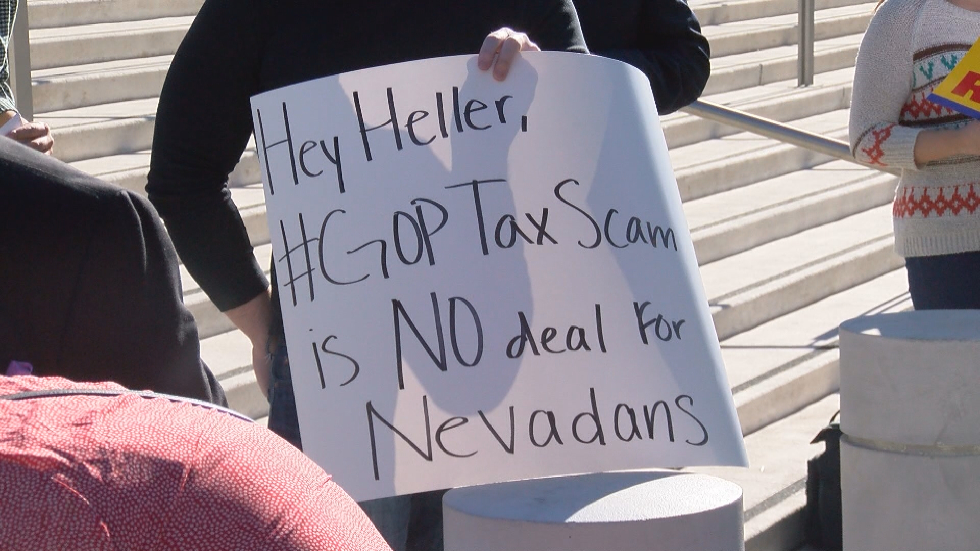 Protesters against the Republican effort to rewrite the tax code gather Wednesday, November 29, 2017, outside the federal courthouse in downtown Las Vegas. (Scott Kost/KSNV)