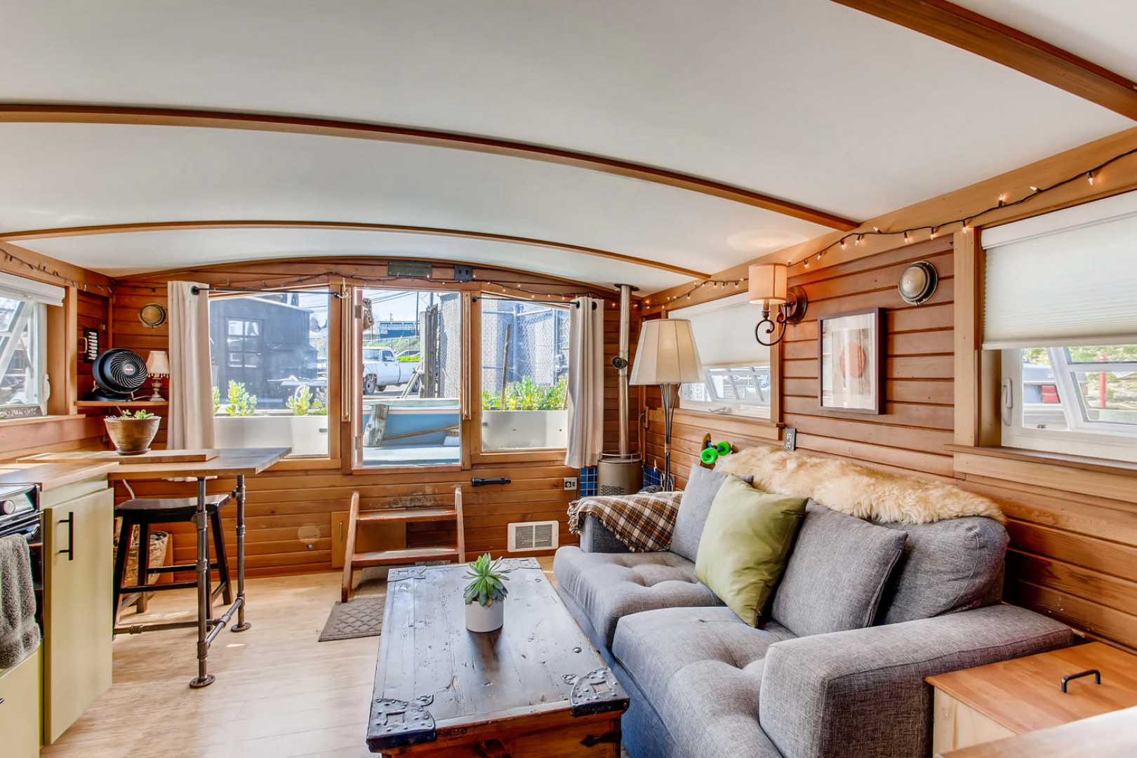 """Orca"" is a small but mighty houseboat on Lake Union, coming in at 240 square feet (336 sq. ft. total lot size). Built in 1982, Orca has a cozy layout featuring an arched ceiling, deck, kitchen and a skylight. This houseboat also comes with the opportunity to expand by adding a second story bedroom with deck (plans have already been drawn up). This houseboat is listed by Alan Braden at $199,000,{&nbsp;}<a  href=""https://alanbraden.rsir.com/homes-for-sale/2401-n-northlake-wy-d1-seattle-wa-98103-1607200-952340/"" target=""_blank"" title=""https://alanbraden.rsir.com/homes-for-sale/2401-n-northlake-wy-d1-seattle-wa-98103-1607200-952340/"">more info online.</a>{&nbsp;}(Image:{&nbsp;}<a  href=""https://www.instagram.com/apnwphotographer/"" target=""_blank"" title=""https://www.instagram.com/apnwphotographer/"">Nicolas Gerlach @apnwphotographer{&nbsp;}</a>/{&nbsp;}<a  href=""https://www.virtuance.com/"" target=""_blank"" title=""https://www.virtuance.com/"">Virtuance</a>)"