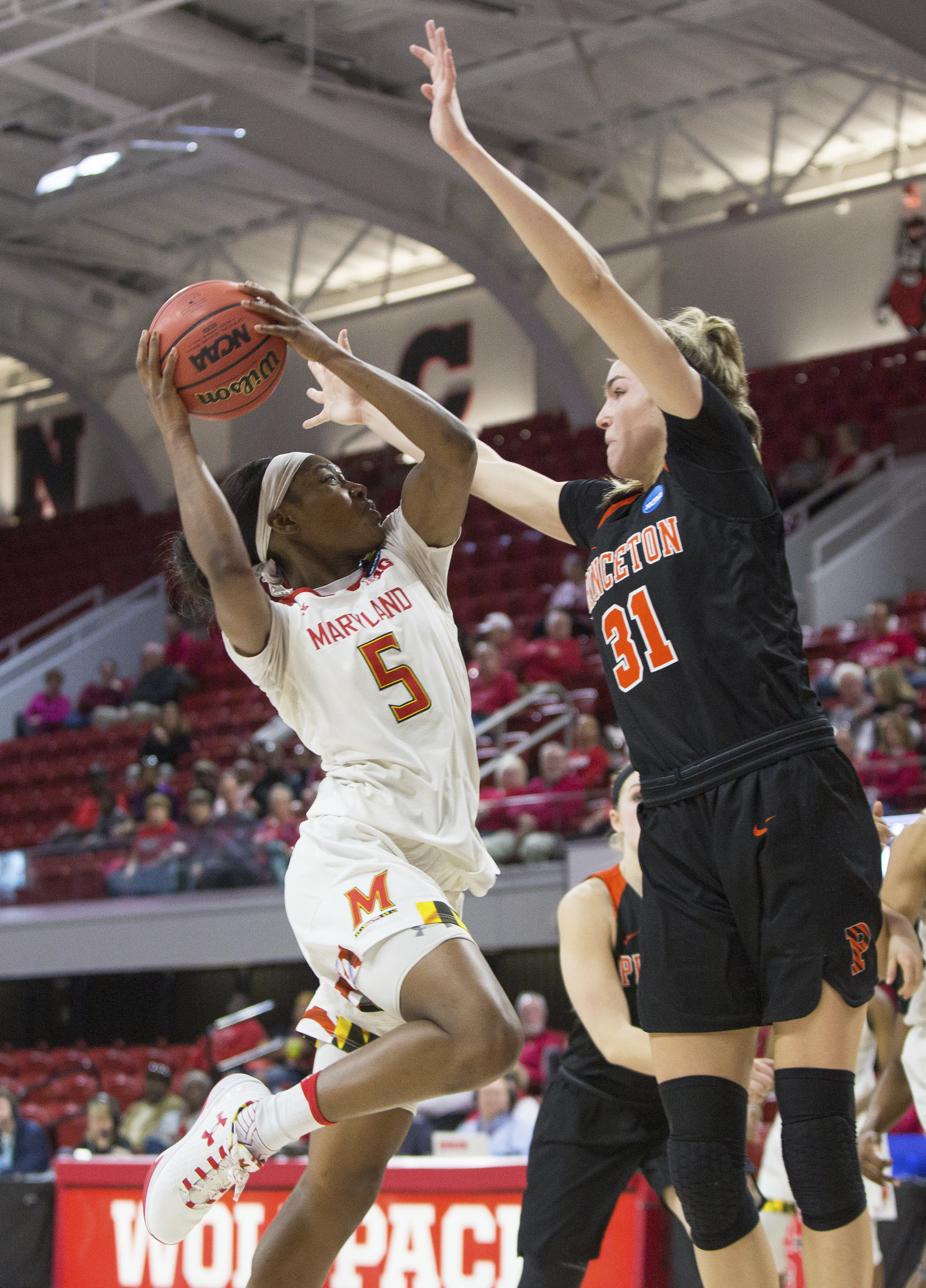 Maryland's Kaila Charles (5) attempts a shot against Princeton's Bella Alarie (31) during the first half of a first-round game in the NCAA women's college basketball tournament in Raleigh, N.C., Friday, March 16, 2018. (AP Photo/Ben McKeown)
