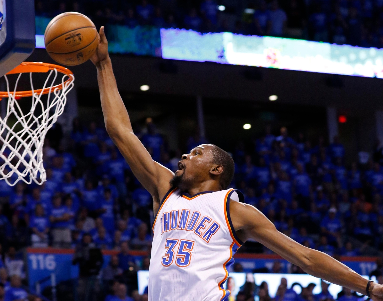 Oklahoma City Thunder forward Kevin Durant (35) dunks in the first quarter of Game 6 of a second-round NBA basketball playoff series against the San Antonio Spurs in Oklahoma City, Thursday, May 12, 2016. (AP Photo/Alonzo Adams)