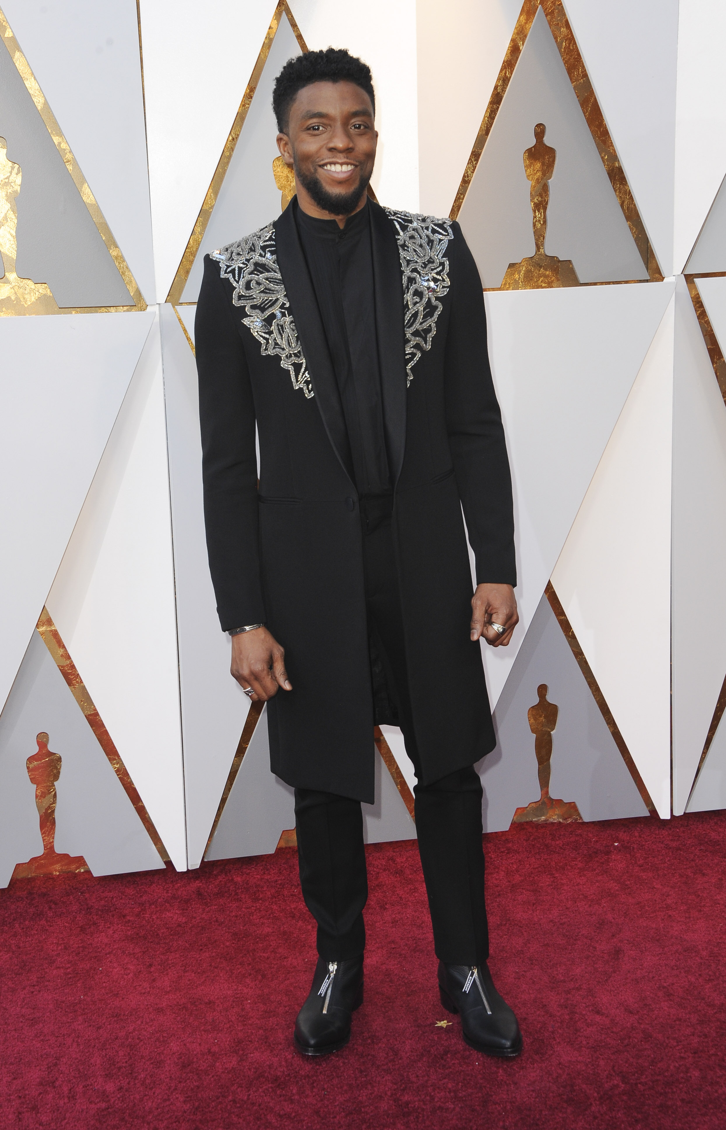 But Lupita wasn't the only Black Panther star looking fine last night! This Howard University grad strutted his stuff in a gorgeous Givenchy topcoat. (Image:(Image: Apega/WENN.com)<p></p>