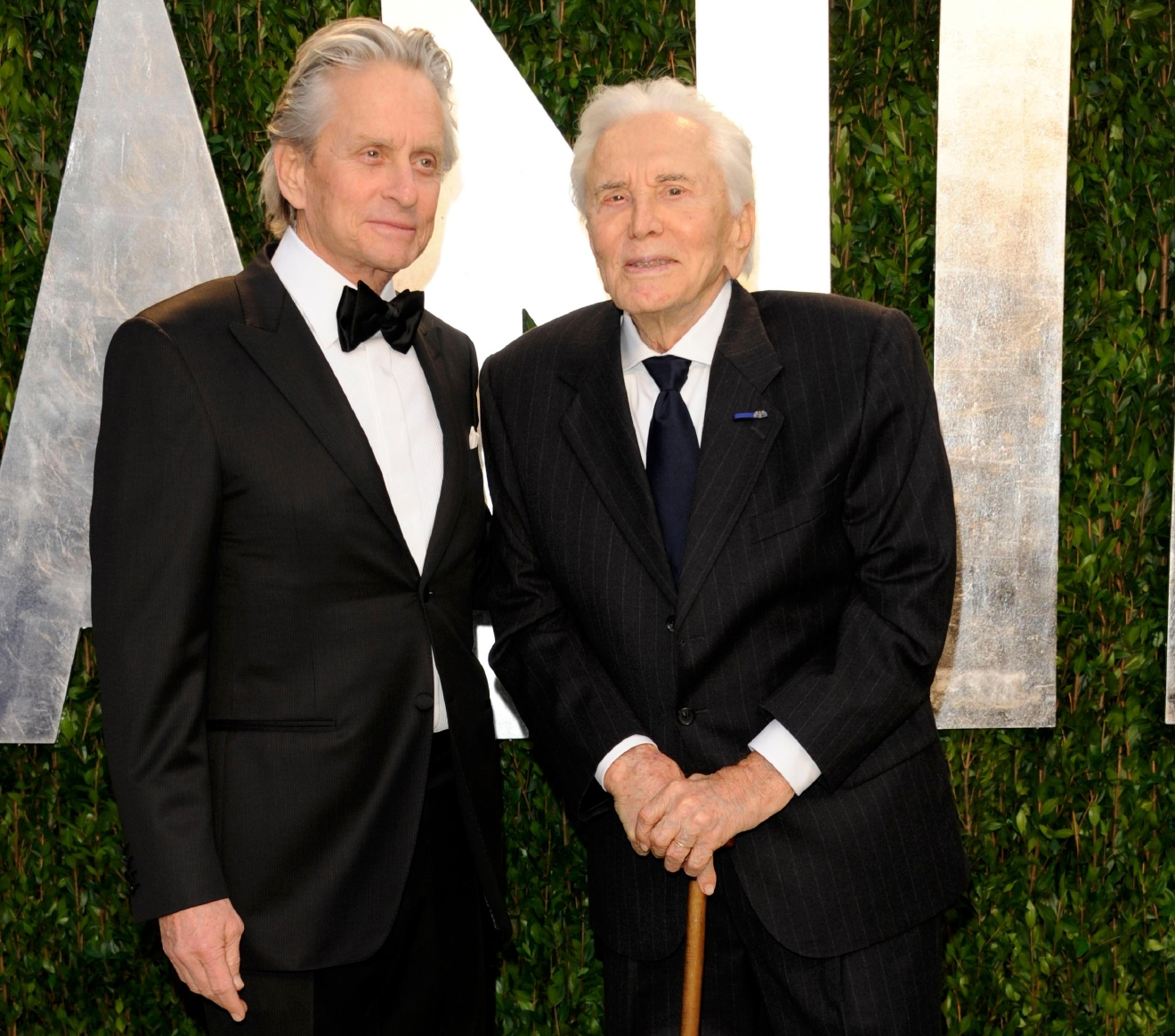 FILE -- In this Feb. 26, 2012, file photo, Michael Douglas, left, and Kirk Douglas arrive at the Vanity Fair Oscar party in West Hollywood, Calif.  (AP Photo/Evan Agostini, File)