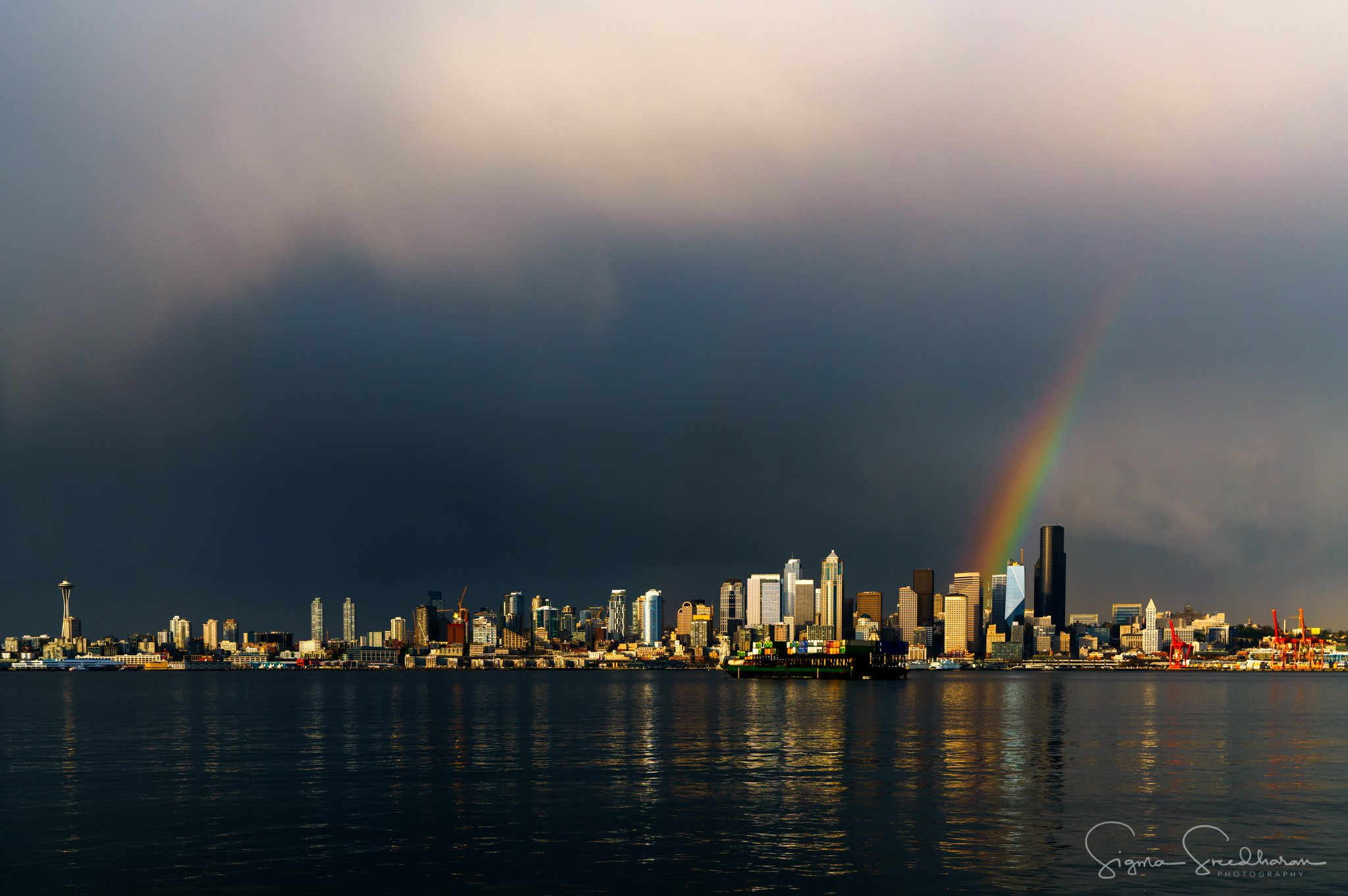 A rainbow brightens dark, stormy skies over downtown Seattle, Tuesday, April 18, 2017. (Photo: Sigma Sreedharan Photography)
