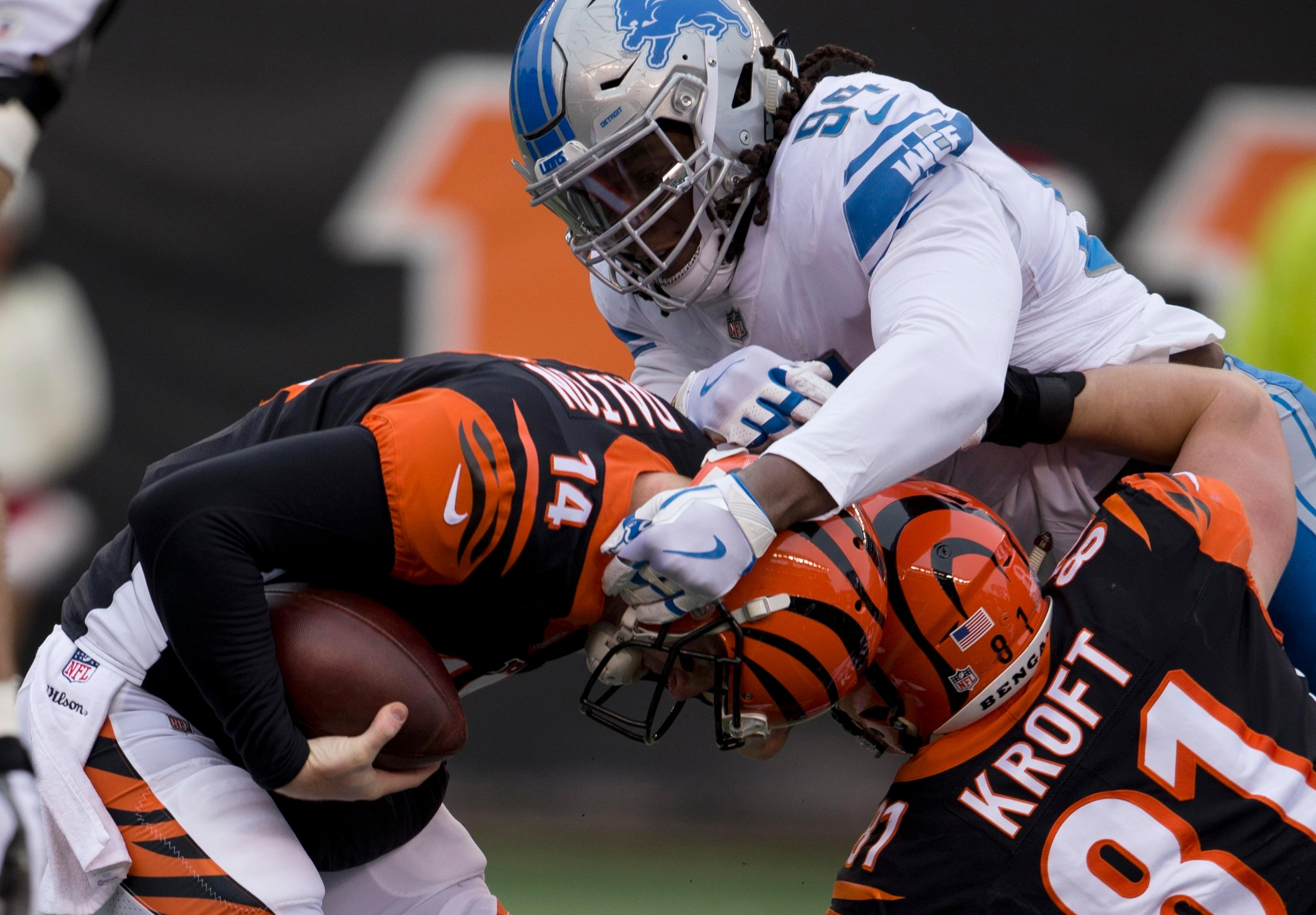 Detroit Lions defensive end Ezekiel Ansah (94) sacks Cincinnati Bengals quarterback Andy Dalton (14) during the first half of an NFL football game, Sunday, Dec. 24, 2017, in Cincinnati. (AP Photo/Frank Victores)