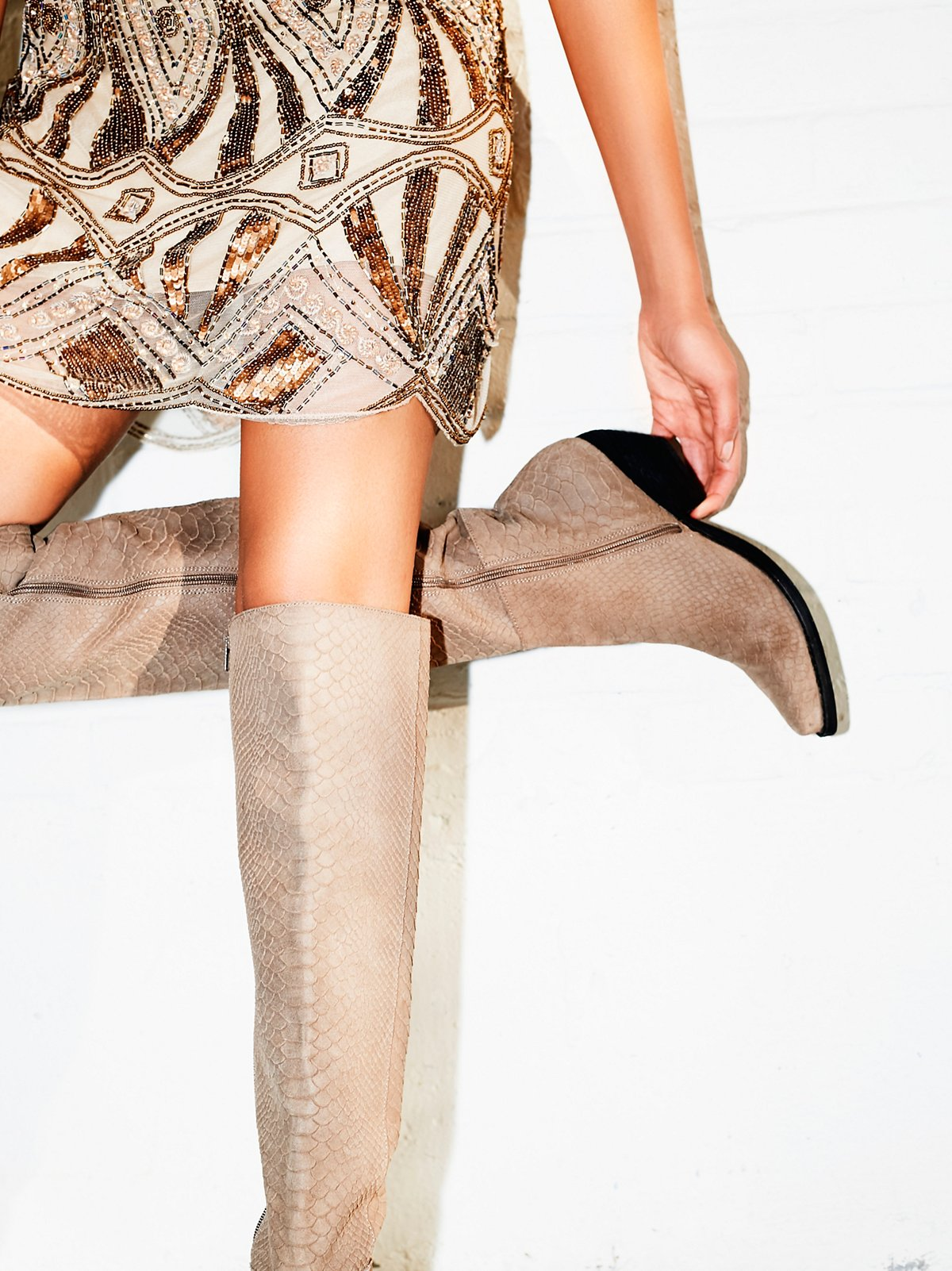 Nailed it!  This 'Limitless Tall Boot' ( $328.00) is the perfect example of a boot that's super versatile and that can change along with the season from outfit to outfit.  It's also not as tight around your knee so it's easier to pair  with jeans. (Image: Free People)