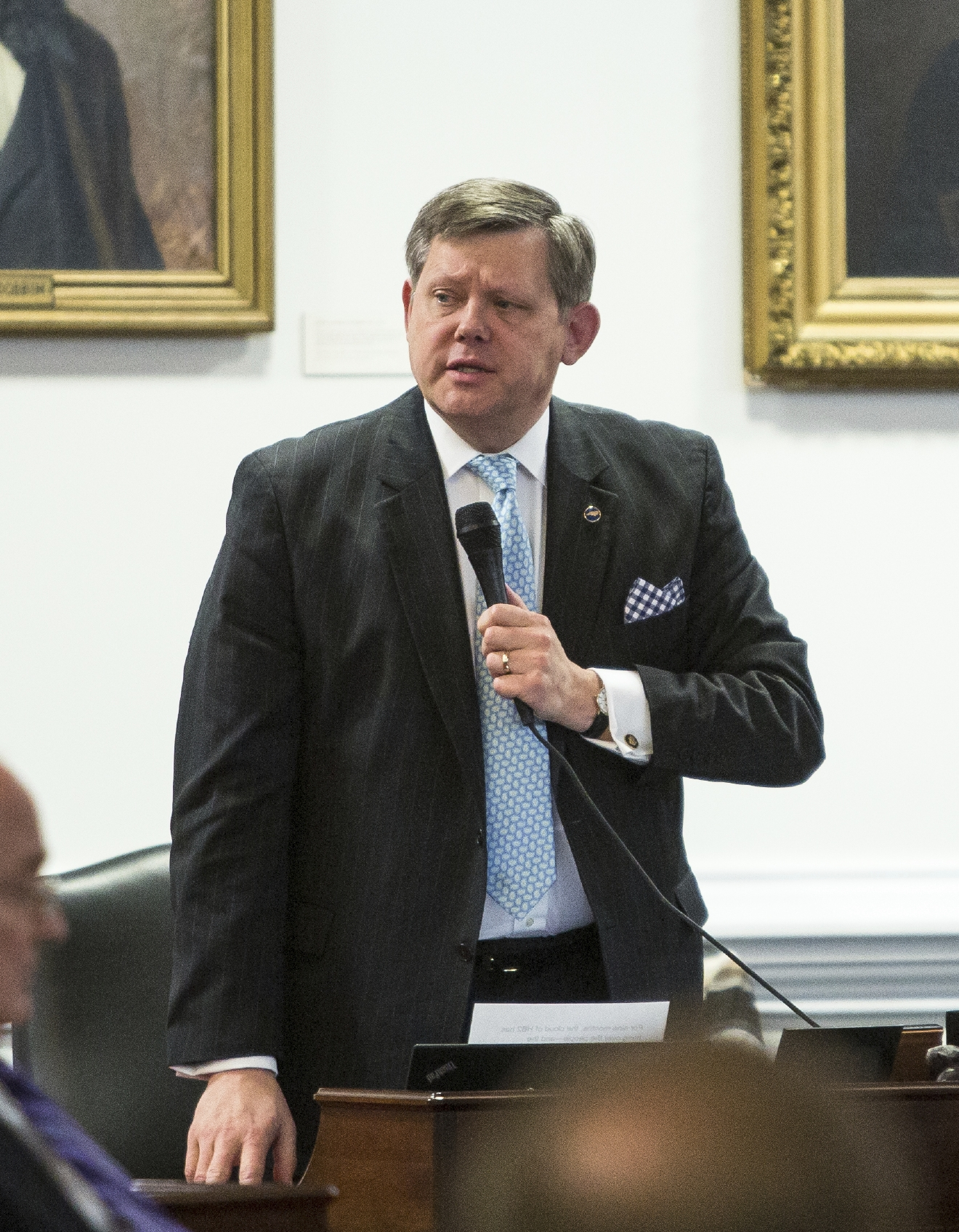 State Sen. Sentor Mike Woodard speaks on the floor of the senate during a special session of the North Carolina General Assembly called to consider repeal of NC HB2 in Raleigh, N.C., Wednesday, Dec. 21, 2016. North Carolina's legislature reconvened to see if enough lawmakers are willing to repeal a 9-month-old law that limited LGBT rights, including which bathrooms transgender people can use in public schools and government buildings.  (AP Photo/Ben McKeown)