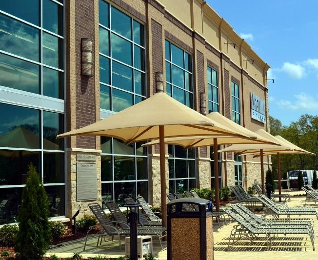 Outdoor pool patio that includes a Life Cafe serving healthy food and beverages.