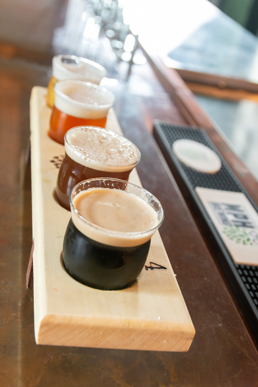 (From top to bottom) Beer flight including Arms Length ( a European light ale that's MPH's most popular beer), Napoleon's Revenge Belgian Tripel, Lancaster English Strong Ale, and Left Hand's Milk Stout Nitro / Image: Elizabeth A. Lowry{ }// Published: 7.20.20