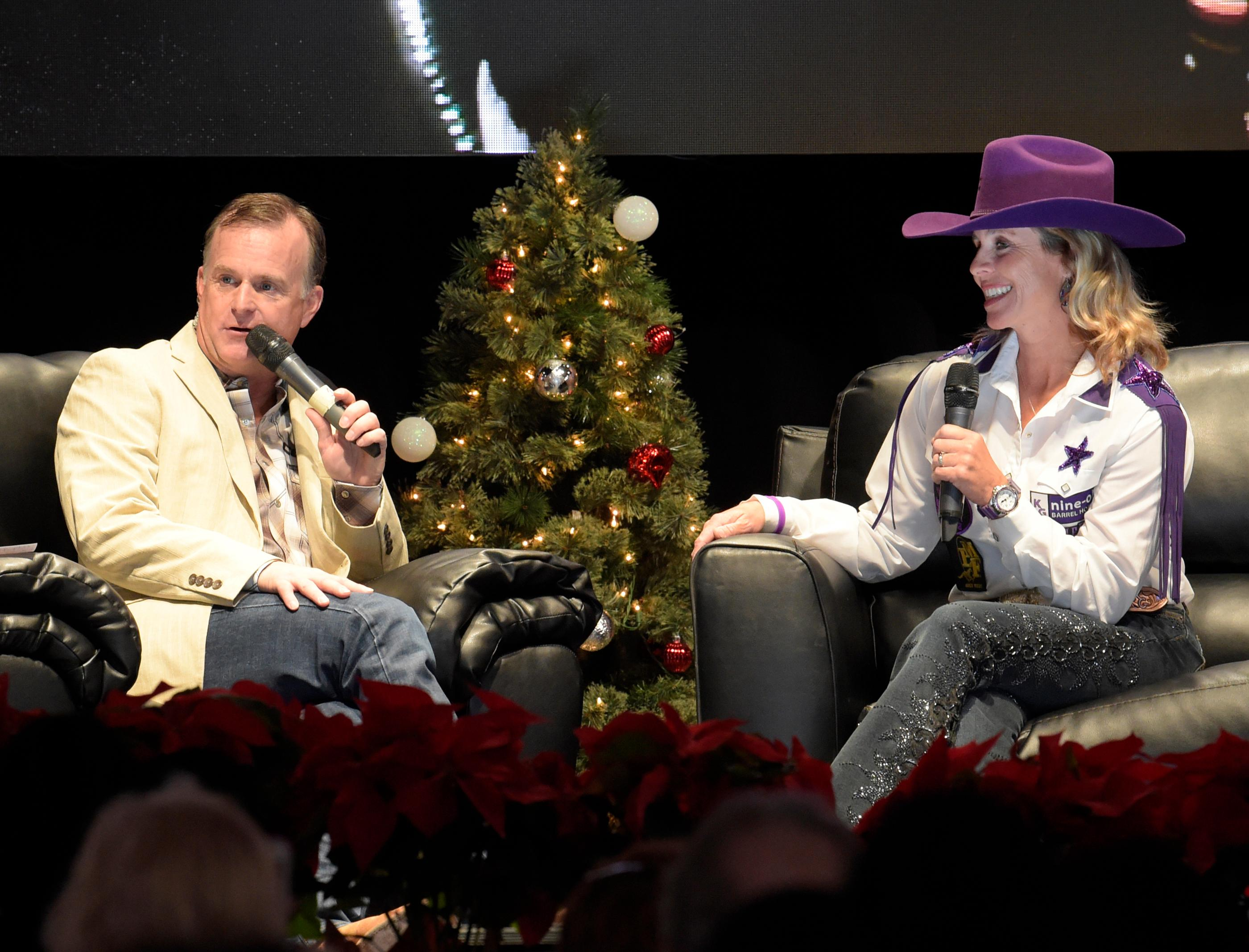"""Outside the Barrel"" with Flint Rasmussen, Entertainer and Rodeo Clown, as he interviews Barrel Racer and Veterinarian Cathy Grahams on the Rodeo Live Stage during Cowboy Christmas at the Las Vegas Convention Center. Sunday December 10, 2017. [Glenn Pinkerton/Las Vegas News Bureau]"