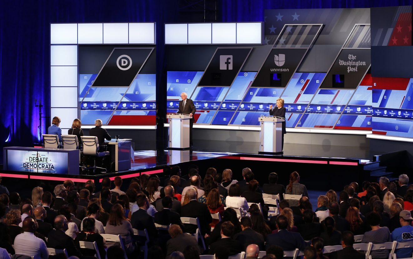 Democratic presidential candidates, Hillary Clinton and Sen. Bernie Sanders, I-Vt, speak at the Univision, Washington Post Democratic presidential debate at Miami-Dade College,  Wednesday, March 9, 2016, in Miami. (AP Photo/Wilfredo Lee)
