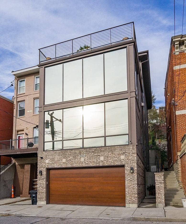<p>502 Baum Street in Mt. Adams in $1,099,000 / High ceilings, hardwood floors, and plenty of open-air space overlooking Downtown are all part of this newer home in Mt. Adams. The two-car garage is a nice addition, and the place has an elevator so you don't have to do stairs if you don't feel like it. The 3,561-square-foot home has three bedrooms and five bathrooms, too. / Our favorite feature: That city view, baby! / Image:{&nbsp;}Rakesh Ram Group // Published: 1.9.20</p>