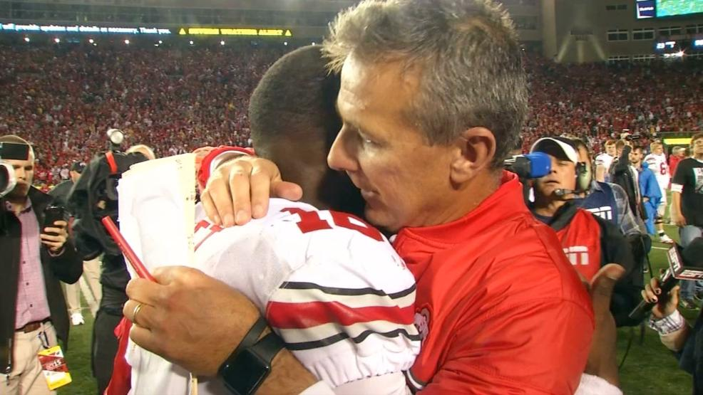 OSU QB J.T. Barrett and head coach Urban Meyer hugging. (WSYX/WTTE)<p></p>