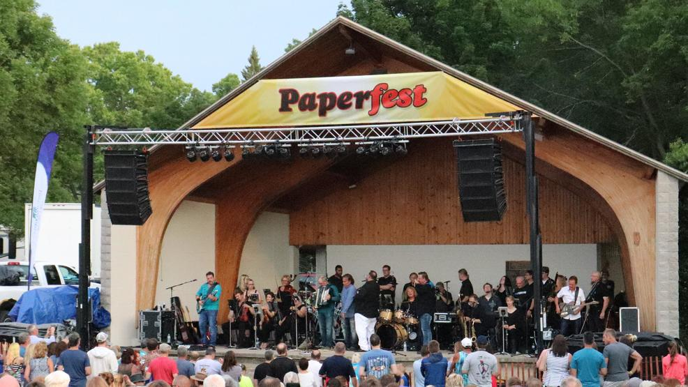 A concert is presented at the Kimberly Amphitheater at Sunset Park during Paperfest.