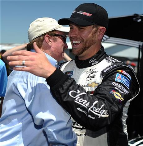 Driver Brian Scott (33) embraces team owner Richard Childress after taking the pole during qualifying for the NASCAR Sprint Cup Series auto race at Talladega Superspeedway, Saturday, May 3, 2014, in Talladega, Ala.