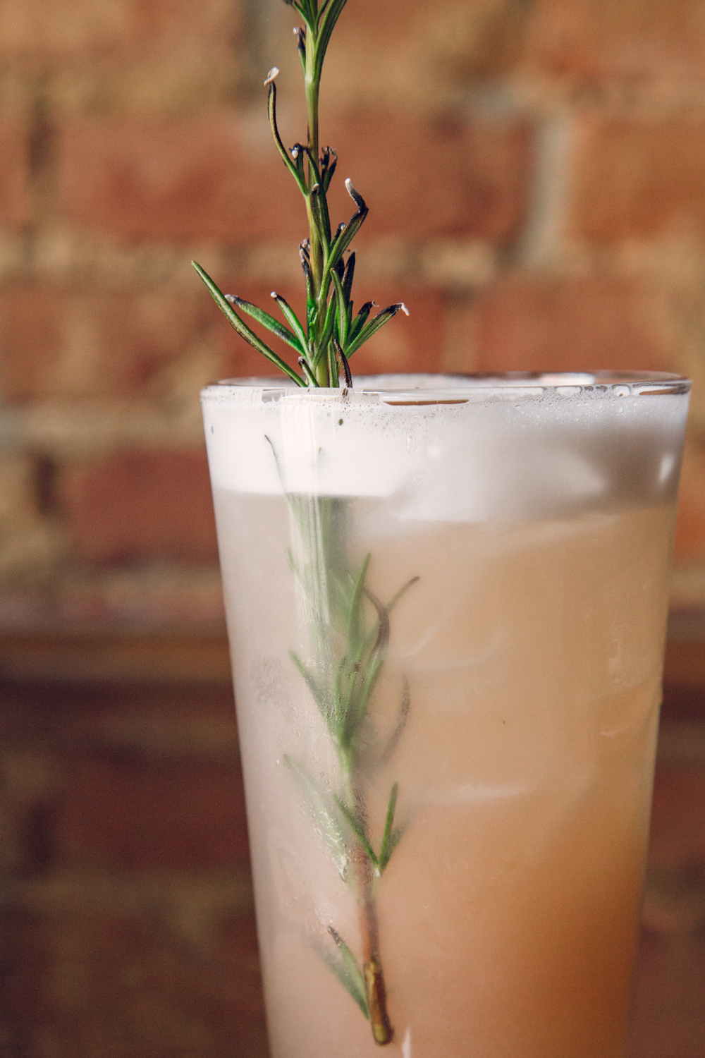 The Mexican Shakedown: a sprig of smoked rosemary, egg whites, and a fruity blend of magical flavor. / Image: Catherine Viox