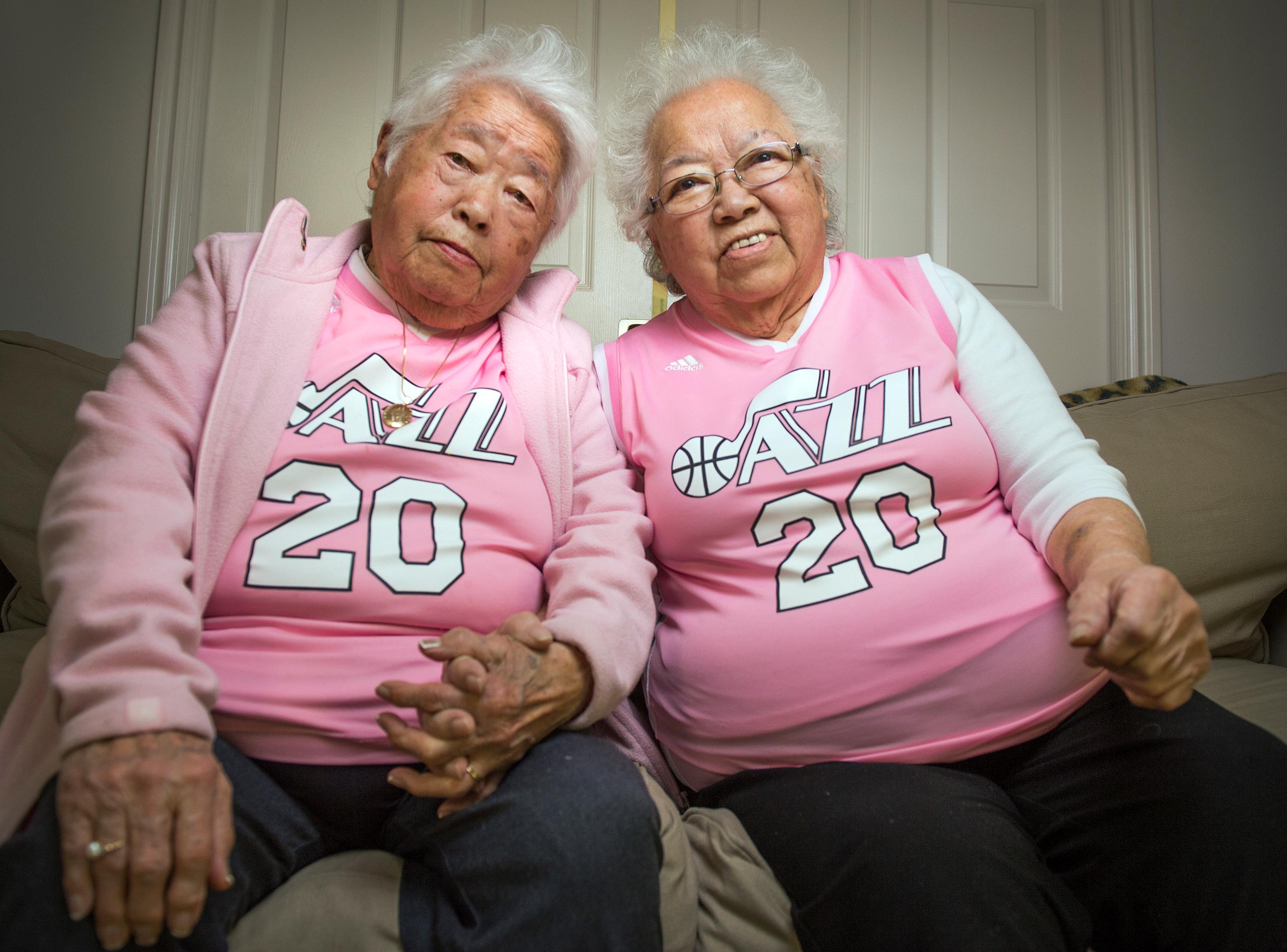 "Chances are that if you've been to a Utah Jazz basketball game, you've seen sister Yeiko Homma and Keiko Mori on the jumbo screens. The two women always dressed in pink jerseys at Jazz games are known locally as ""The Pink Grandmas."" The two are ready to watch game 7 of the playoff series between the Utah Jazz and the Los Angeles Clippers, Sunday, April 30, 2017.   (Leah Hogsten /The Salt Lake Tribune via AP)"