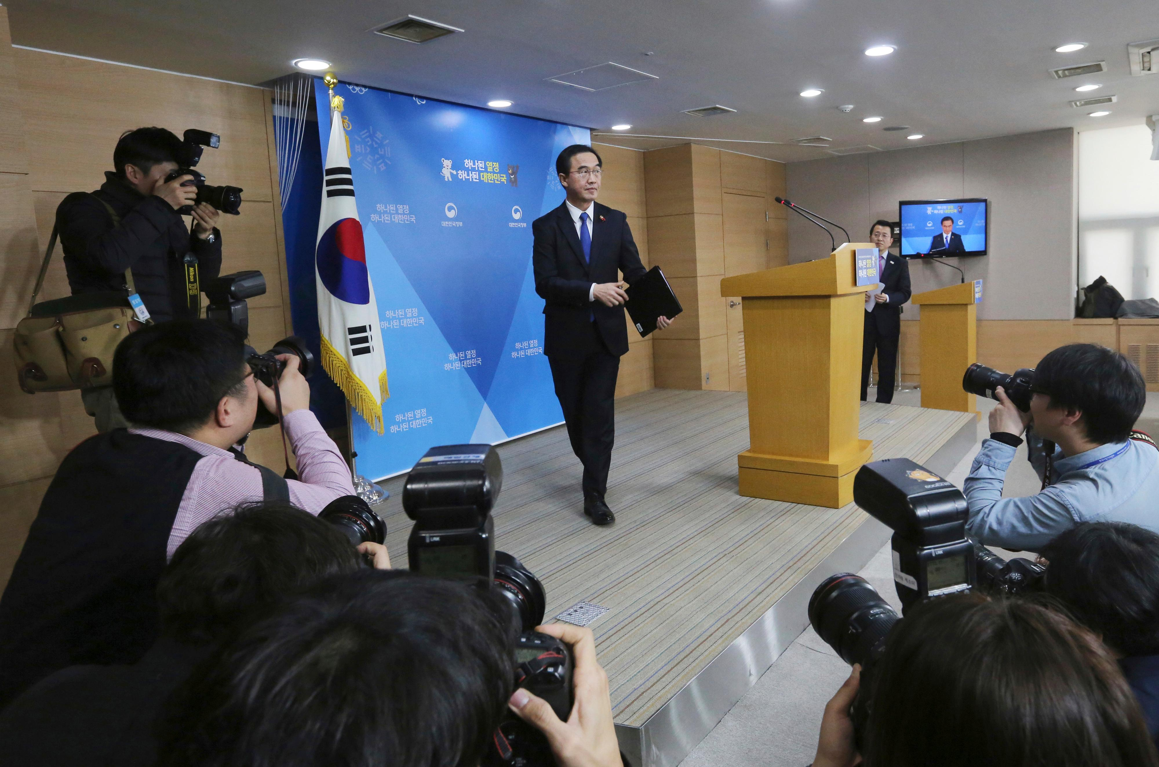South Korean Unification Minster Cho Myoung-gyon leaves after a press conference at the government complex in Seoul, South Korea, Tuesday, Jan. 2, 2018. Cho on Tuesday offered high-level talks with rival North Korea meant to find ways to cooperate on the Winter Olympics set to begin in the South next month. (AP Photo/Ahn Young-joon)