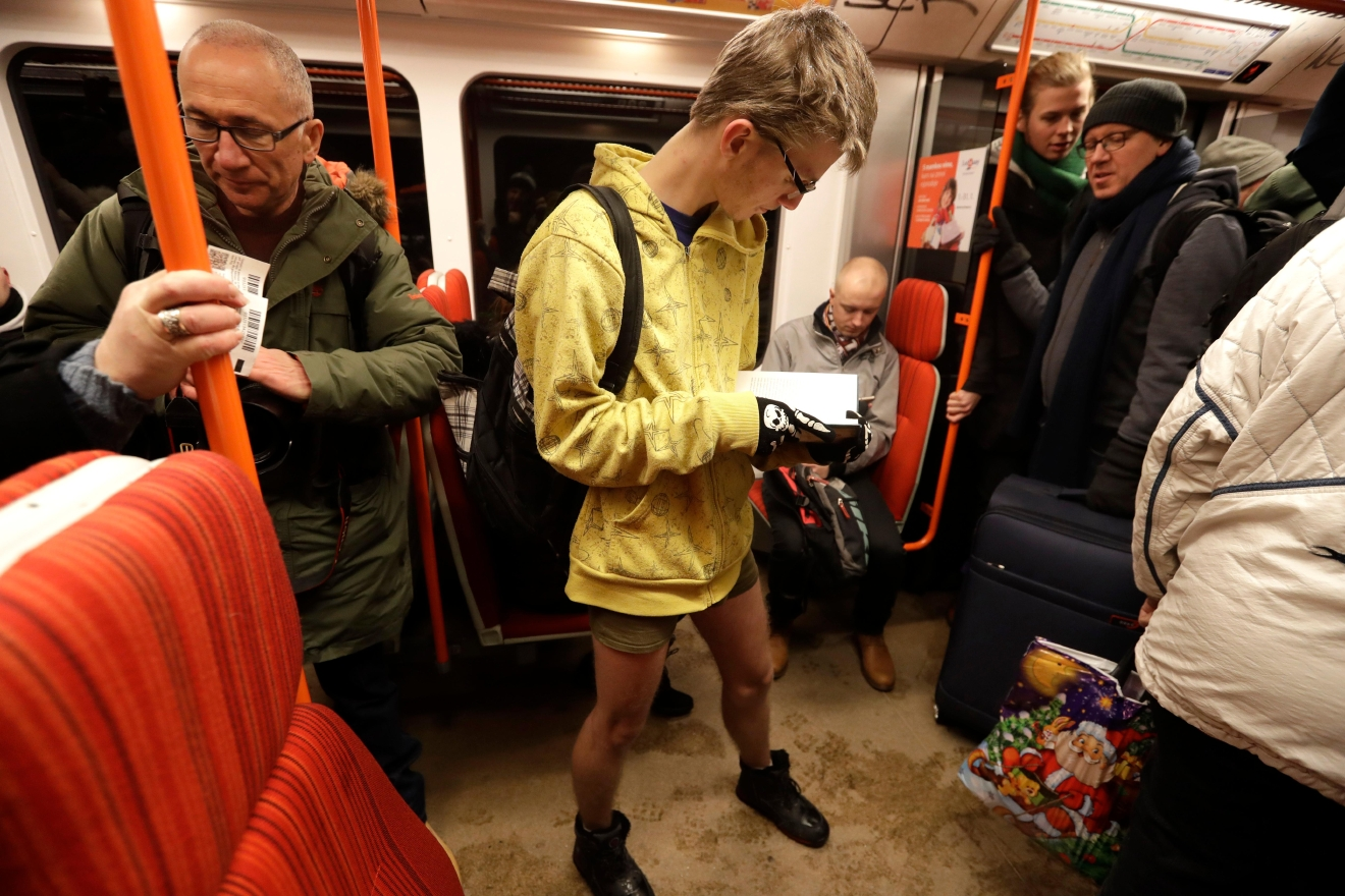 Passenger reads a book while taking part in the No Pants Subway Ride in Prague, Czech Republic, Sunday, Jan. 8, 2017. The No Pants Subway Ride began in 2002 in New York as a stunt and has taken place in cities around the world since then. (AP Photo/Petr David Josek)