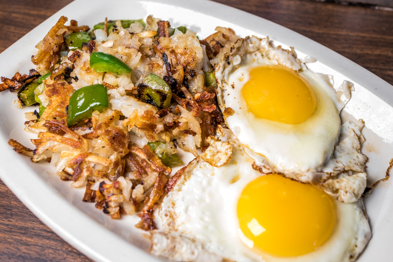 Shredded hash browns with peppers, onions, and two sunny side eggs / Image: Catherine Viox // Published: 9.4.20