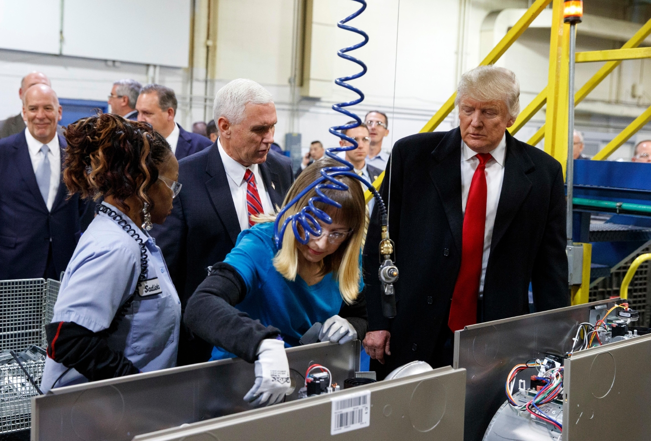 President-elect Donald Trump and Vice President-elect Mike Pence watch as employees work during a visit to Carrier factory, Thursday, Dec. 1, 2016, in Indianapolis, Ind. (AP Photo/Evan Vucci)
