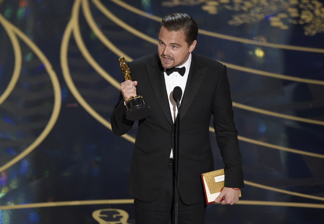 Leonardo DiCaprio accepts the award for best actor in a leading role for Â?The RevenantÂ? at the Oscars on Sunday, Feb. 28, 2016, at the Dolby Theatre in Los Angeles. (Photo by Chris Pizzello/Invision/AP)