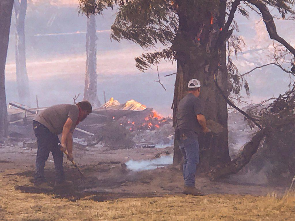Residents work to save their homes on Emerson Loop Road near The Dalles from a wildfire burning southeast of town Tuesday, July 17, 2018. (Photo: Corry Young/KATU News)