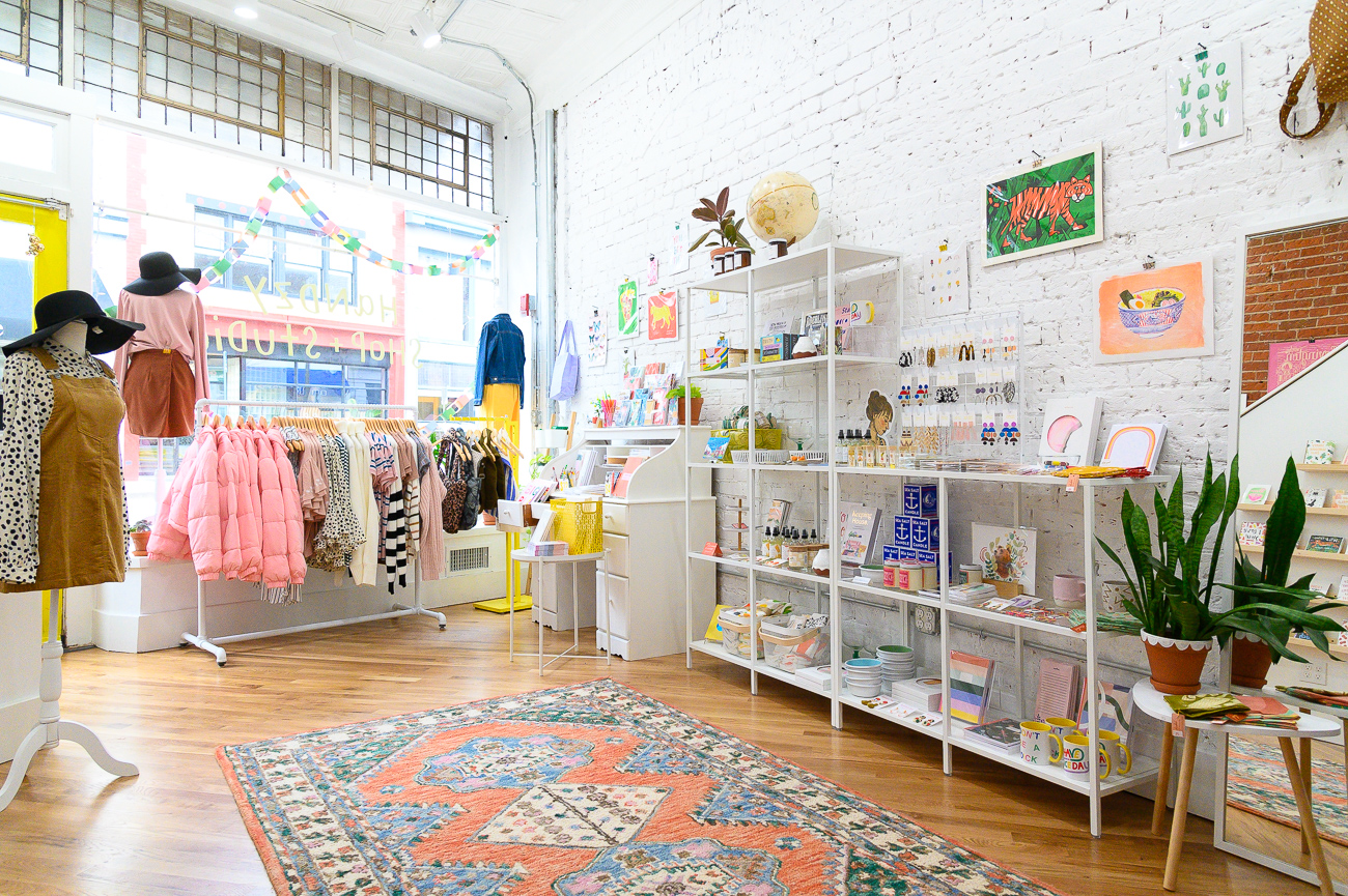 The new location is larger than Handzy's previous shop. With a whole upstairs level centered around fashion, Handzy's offerings have grown since the move in November. So too has the business itself; it began as a stationery and design shop, and has since adapted to the market by offering clothing and other items over time. While its online store sells products found in the Covington shop, the shop itself sells additional items that aren't listed online. / Image: Phil Armstrong, Cincinnati Refined // Published: 12.18.19