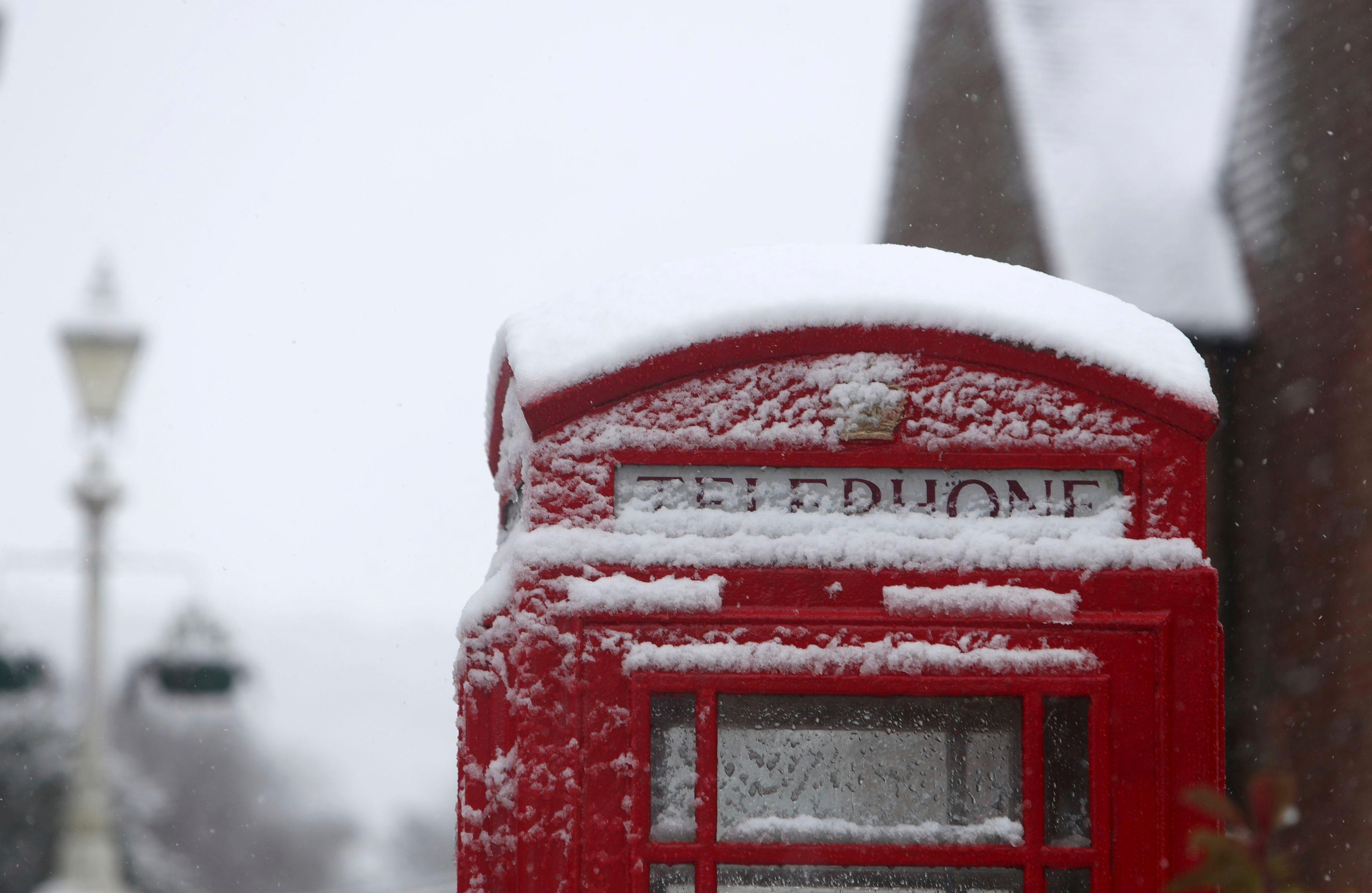 A snow covered phone box in Marlow, England, after heavy snow fell across parts of the UK, Sunday Dec. 10, 2017.  Snow is causing travel disruptions across central England and northern Wales, grounding some flights and shutting down roads. (Steve Parsons/PA via AP)