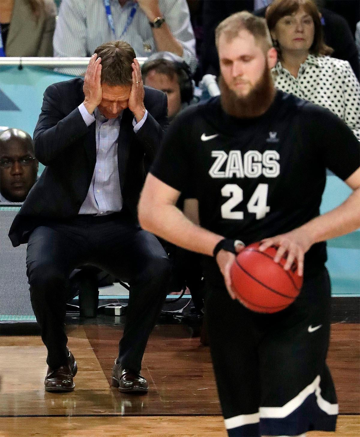 Gonzaga head coach Mark Few reacts as Przemek Karnowski (24) walks down on the court during the second half in the finals of the Final Four NCAA college basketball tournament, Monday, April 3, 2017, in Glendale, Ariz. (AP Photo/Matt York)