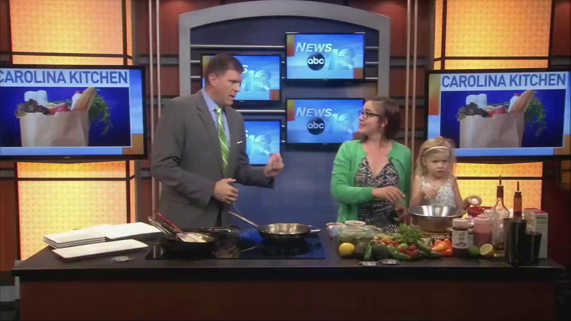 Emily Abernathy of Chupacabra Latin Cafe joins News 13's Evan Donovan to make her shrimp & chorizo frittata, salmon cakes and strawberry-basil margarita (Photo credit: WLOS staff)
