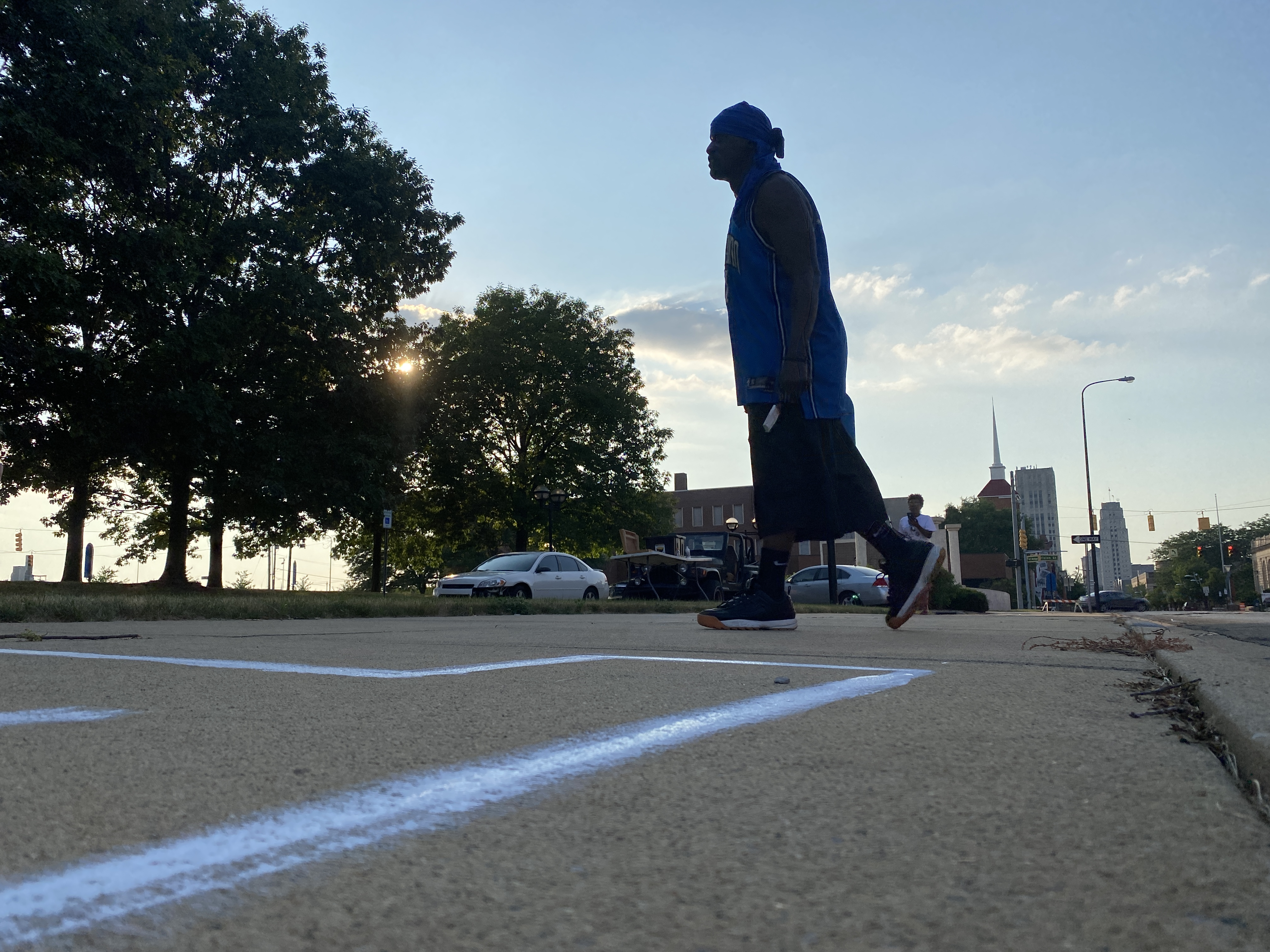 Gerald King of Battle Creek{ } moves on to the next letter in Black Lives Matter, for the city's sidewalk mural project. (WWMT/Jason Heeres)