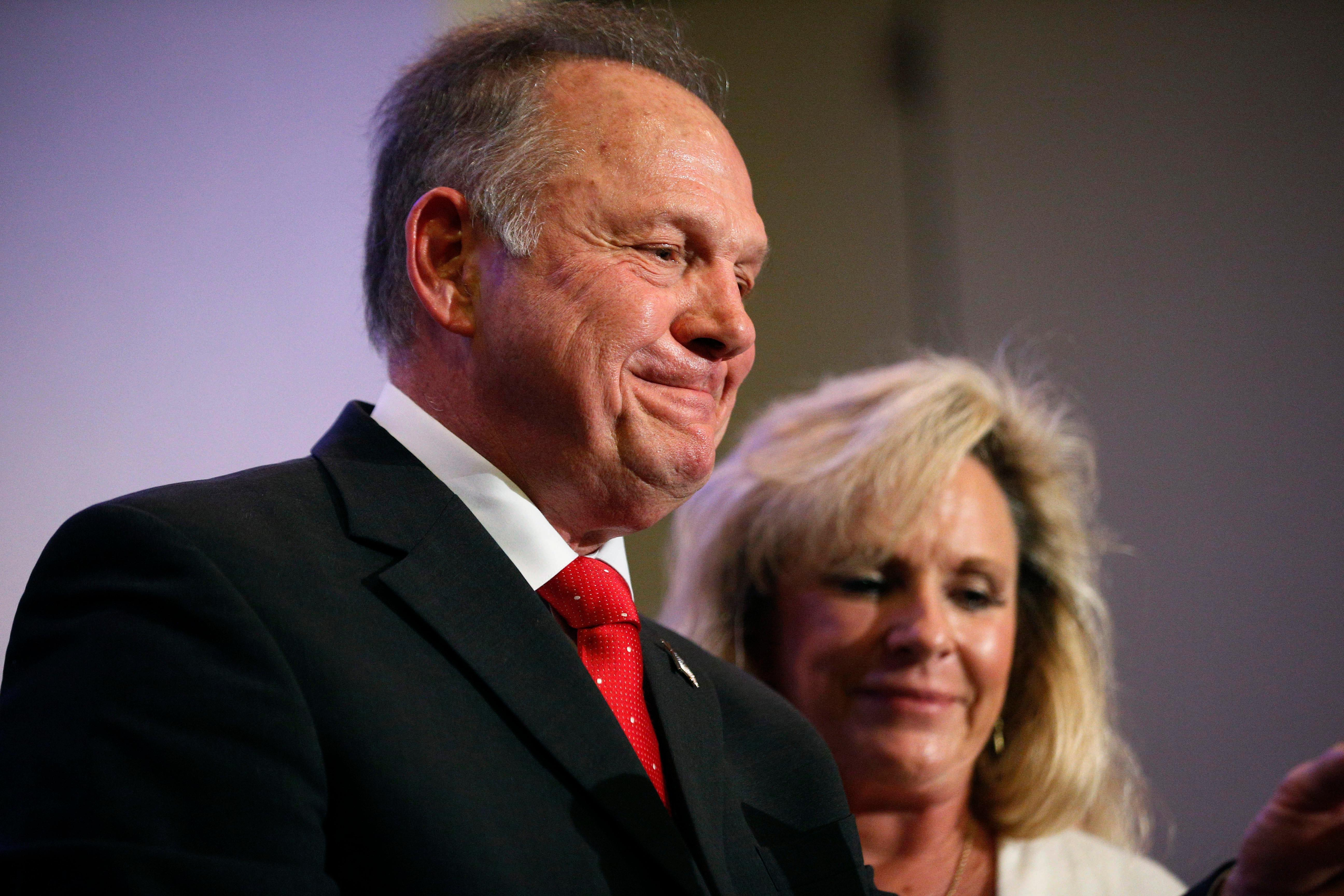 Former Alabama Chief Justice and U.S. Senate candidate Roy Moore speaks at a news conference, Thursday, Nov. 16, 2017, in Birmingham, Ala., with his wife Kayla Moore, right. (AP Photo/Brynn Anderson)