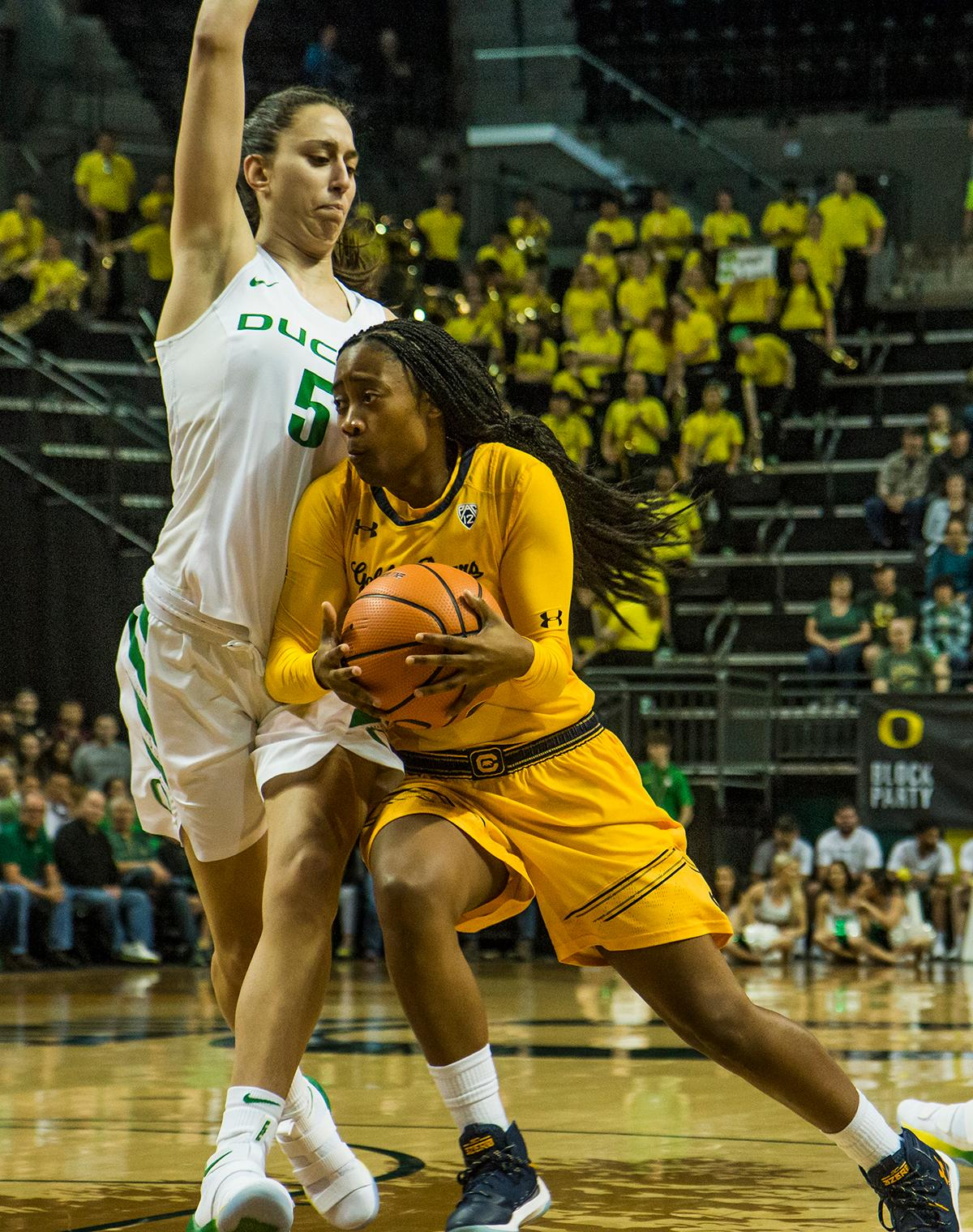 Cal Bears Asha Thomas (#1) drives past Oregon Ducks Maite Cazorla (#5) during the 1st quarter. The Oregon Ducks women's team defeated the Cal Golden Bears 91-54 in Matthew Knight Arena Saturday evening. The Ducks had 3 players in double digits: Sabrina Ionescu with 28 points; Ruthy Hebard with 18 points; and Satou Sabally with 10 points. The Ducks now stand at 10-1 in conference play and Cal drops to 6-5. Photo by Kezia Setyawan, Oregon News Lab