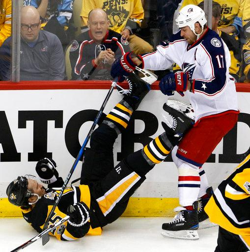 Columbus Blue Jackets' Brandon Dubinsky (17) collides with Pittsburgh Penguins' Ron Hainsey (65) during the first period in Game 2 of an NHL first-round hockey playoff series in Pittsburgh, Friday, April 14, 2017. (AP Photo/Gene J. Puskar)