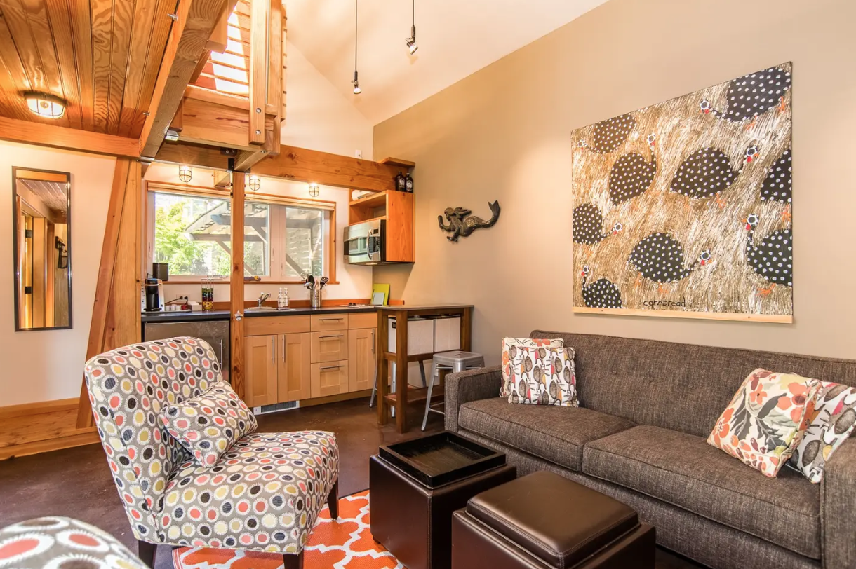 "Wait, can we actually just live here? This tiny home in Ballard is up for{&nbsp;}<a  href=""https://www.airbnb.com/rooms/8106157?source_impression_id=p3_1567631731_PaeDIw1%2BtGZv1npm"" target=""_blank"" title=""https://www.airbnb.com/rooms/8106157?source_impression_id=p3_1567631731_PaeDIw1%2BtGZv1npm"">rent by AirBnb for $120/per night.</a>{&nbsp;}It's an entire guesthouse is 363 square feet with 1 bedroom 1 bed and bath. It's a self check in and is sparkling clean. The converted garage has been on AirBnb since 2016 and has hosted 250 guests so far. The house is easy walking distance from coffee shops, restaurants, markets and retail stores. Staycation, anyone?{&nbsp;}(Image: Rudy Lopez / Curb Appeal)"