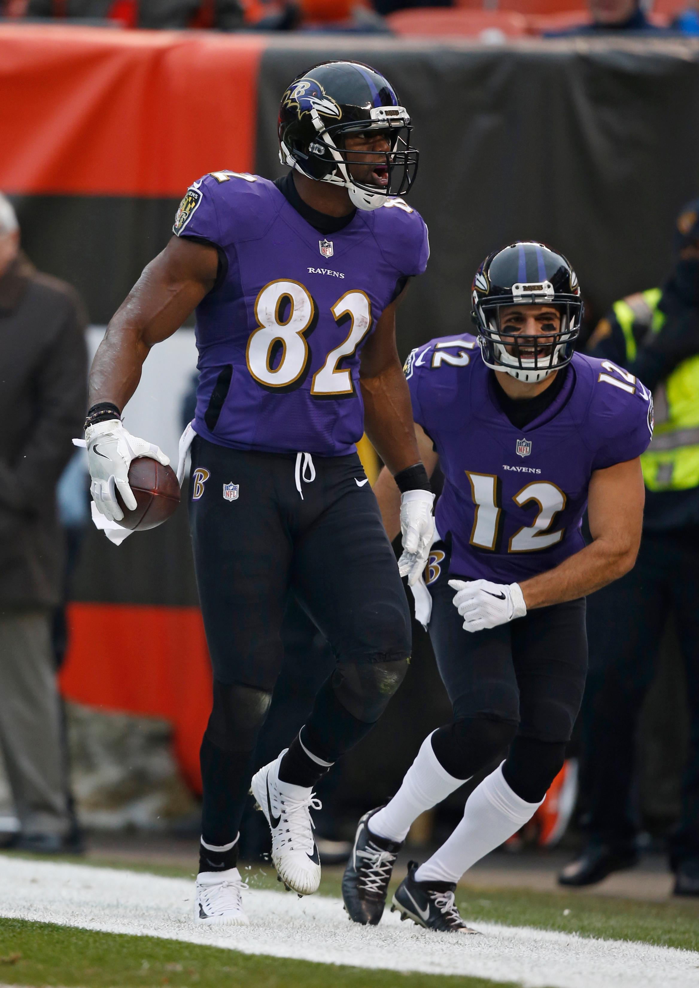 Baltimore Ravens tight end Benjamin Watson (82) celebrates after a 33-yard touchdown during the first half of an NFL football game against the Cleveland Browns, Sunday, Dec. 17, 2017, in Cleveland. (AP Photo/Ron Schwane)