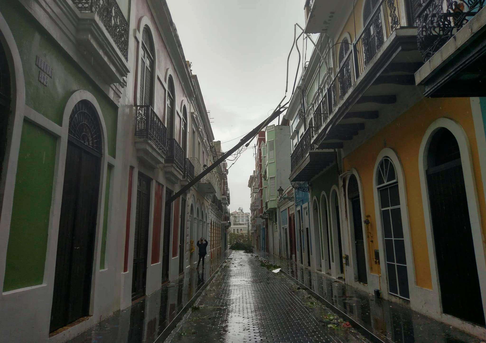 In this photo replaced by Jason Heskew, an electric pole lays after it snapped in half during Hurricane Maria in Old San Juan, Puerto Rico, Wednesday, Sept. 20, 2017. The strongest hurricane to hit Puerto Rico in over 80 years tore off roofs and doors, knocked out power across the entire island and unleashed heavy flooding. (Jason Heskew via AP)