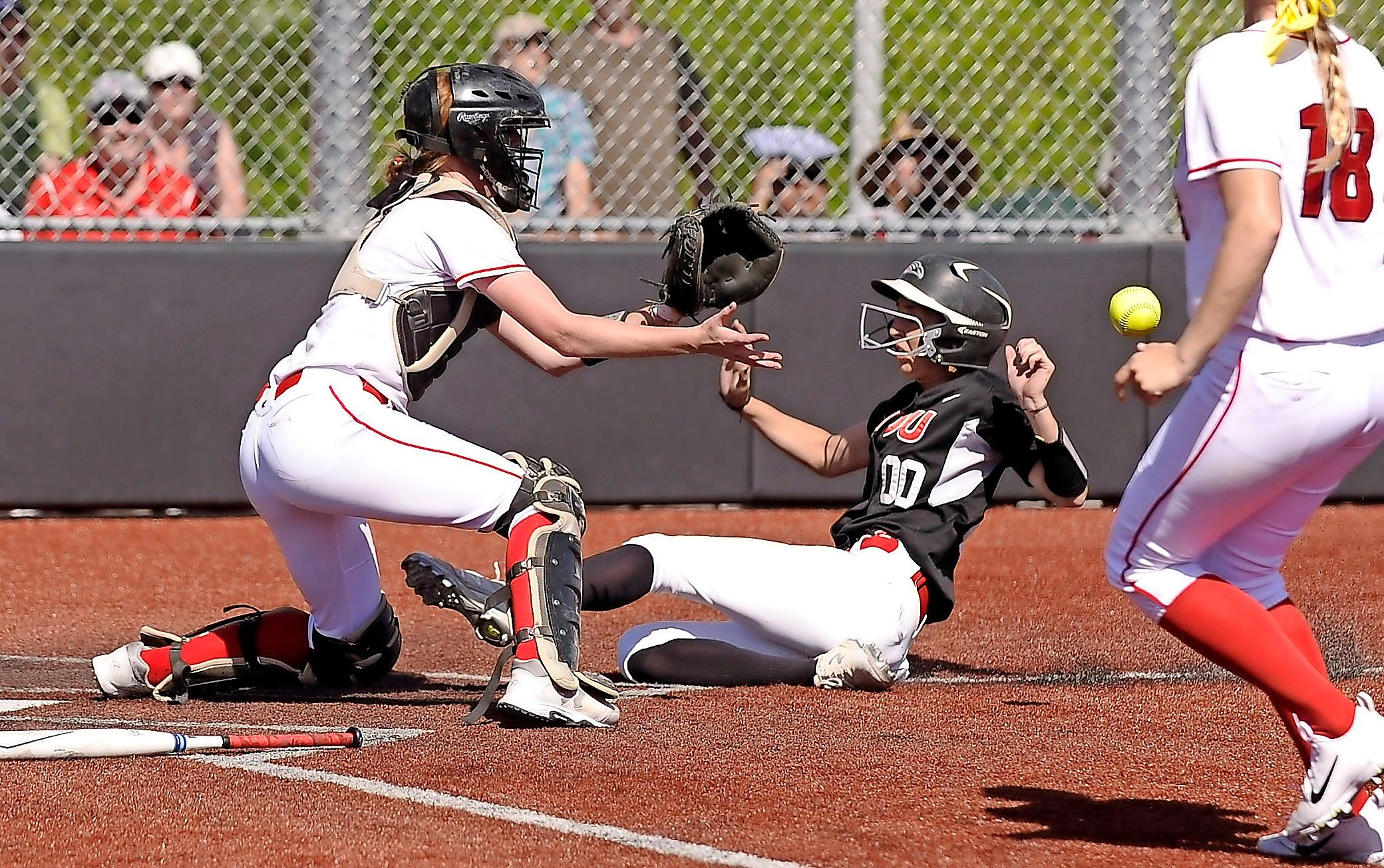 Andy Atkinson/Daily Tidings<p>Southern Oregon University second baseman Hannah Shimek beats the throw at home to score what proved to be the game-winning run in the bottom of the fifth inning against Northwestern College on Tuesday.<br></p>