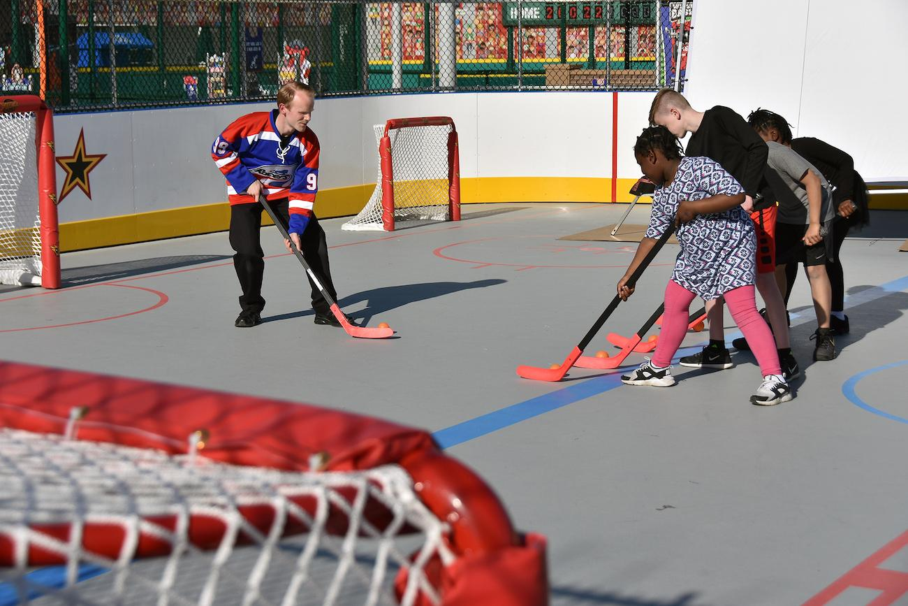 The Indy Fuel Hockey Experience provides opportunities to learn how to pass, shoot, and score in street hockey. / Image courtesy of Children's Museum of Indianapolis // Published: 4.2.19