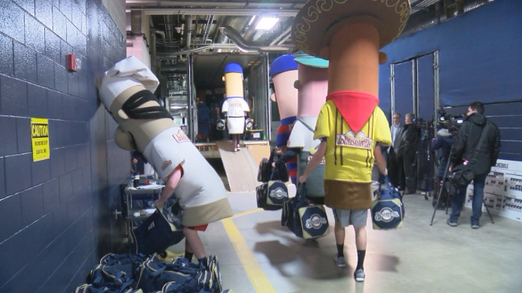 Even the Racing Sausages pitched in as team officials loaded the equipment truck.