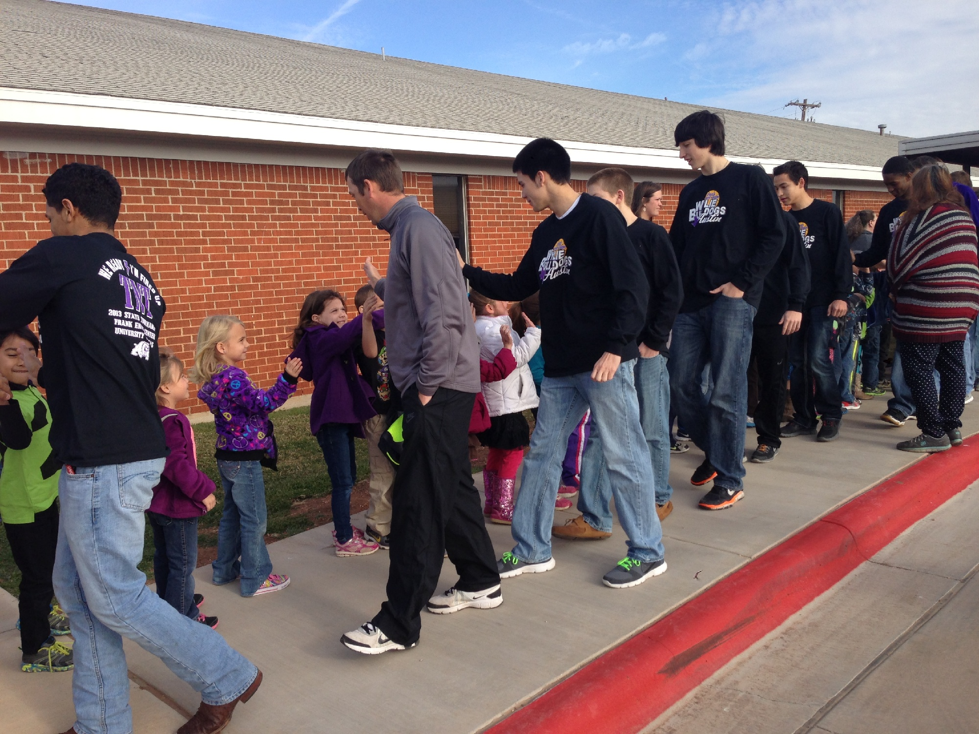 Students showed support for Wylie basketball players during a send-off Wednesday. The Bulldogs (34-4) are headed to Austin to compete in the state basketball tournament.Photo courtesy of Lupe Hererra