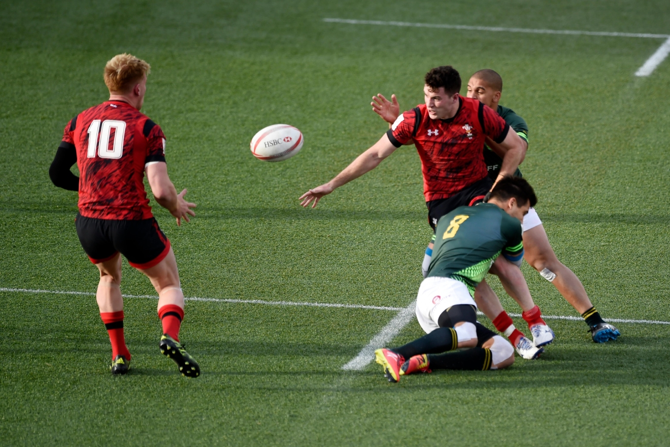 Wales' Owen Jenkins passes to teammate Sam Cross during their match against South Africa at the USA Sevens rugby tournament Saturday, March 4, 2017, at Sam Boyd Stadium. [Sam Morris/Las Vegas News Bureau]