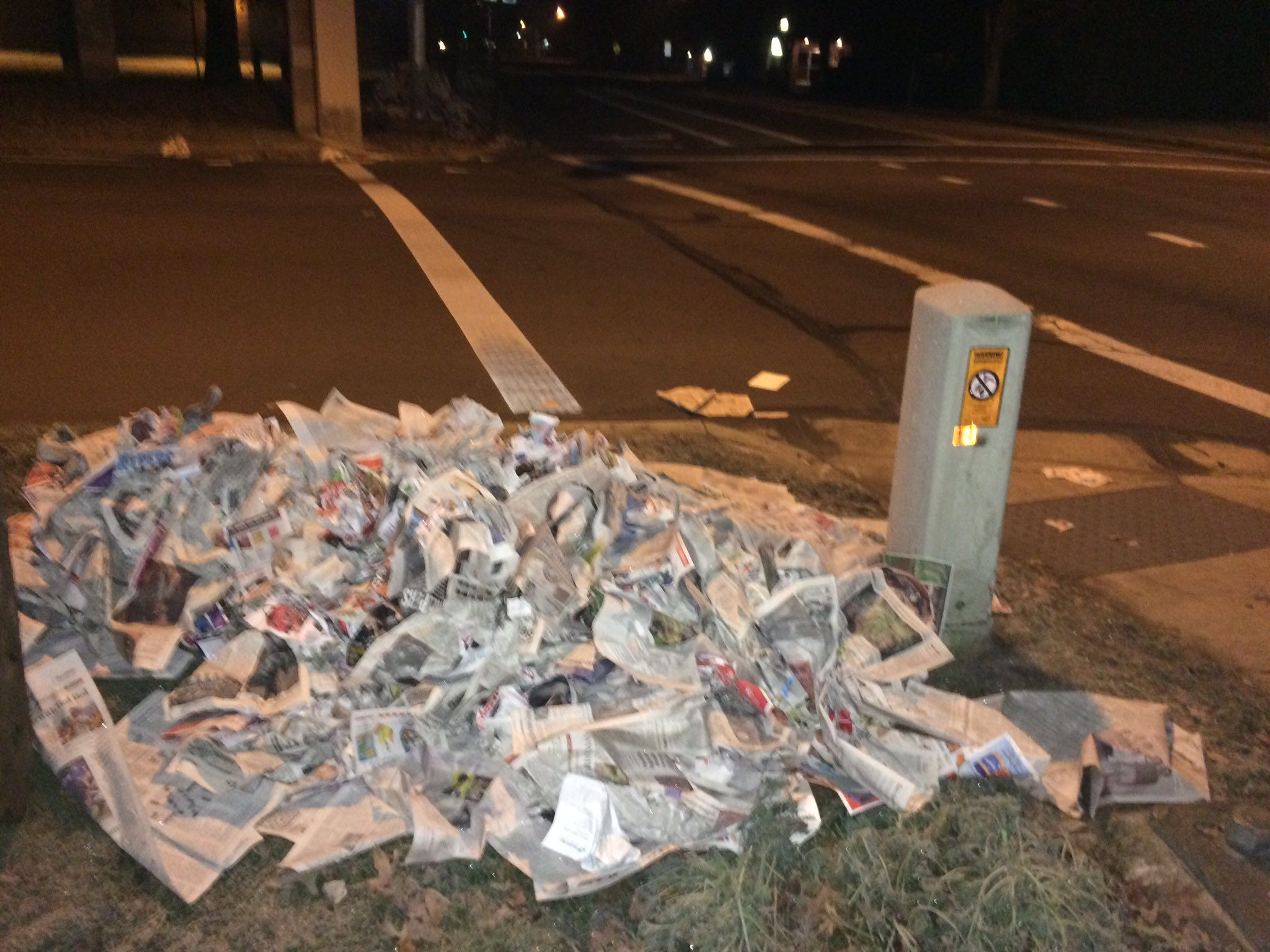 The newspapers had made it as far as the sidewalk by 6 a.m. Tuesday. (Ellen Meny)
