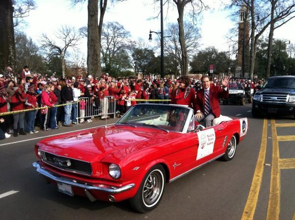 Nick Saban and wife, Terry, wave to Alabama fans during the BCS Champions parade on Saturday, January 19, 2013.