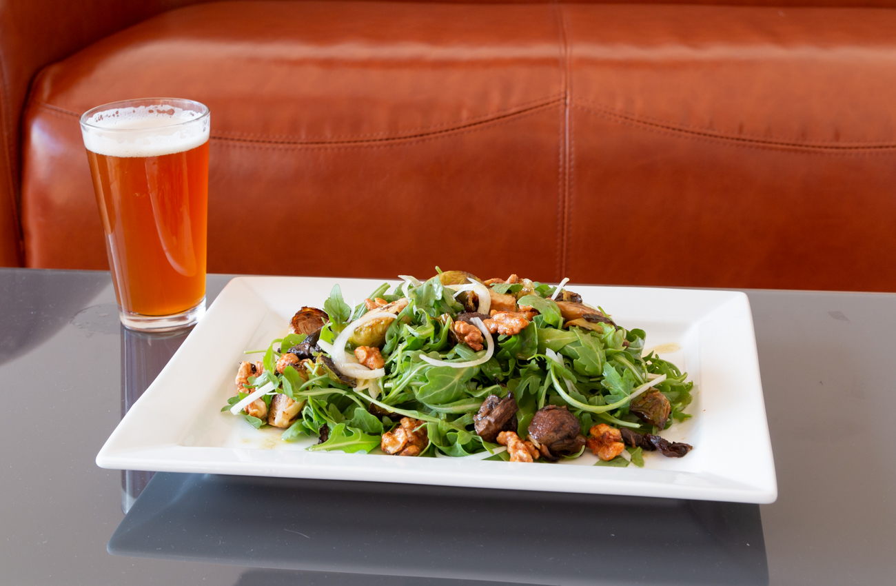 Baby Brussels & Bella Salad: roasted baby bella mushrooms, Brussels sprouts, sweet white onions, arugula, and spiced walnuts topped with a lemon oregano vinaigrette. / Image: Elizabeth Lowry // Published: 11.5.19