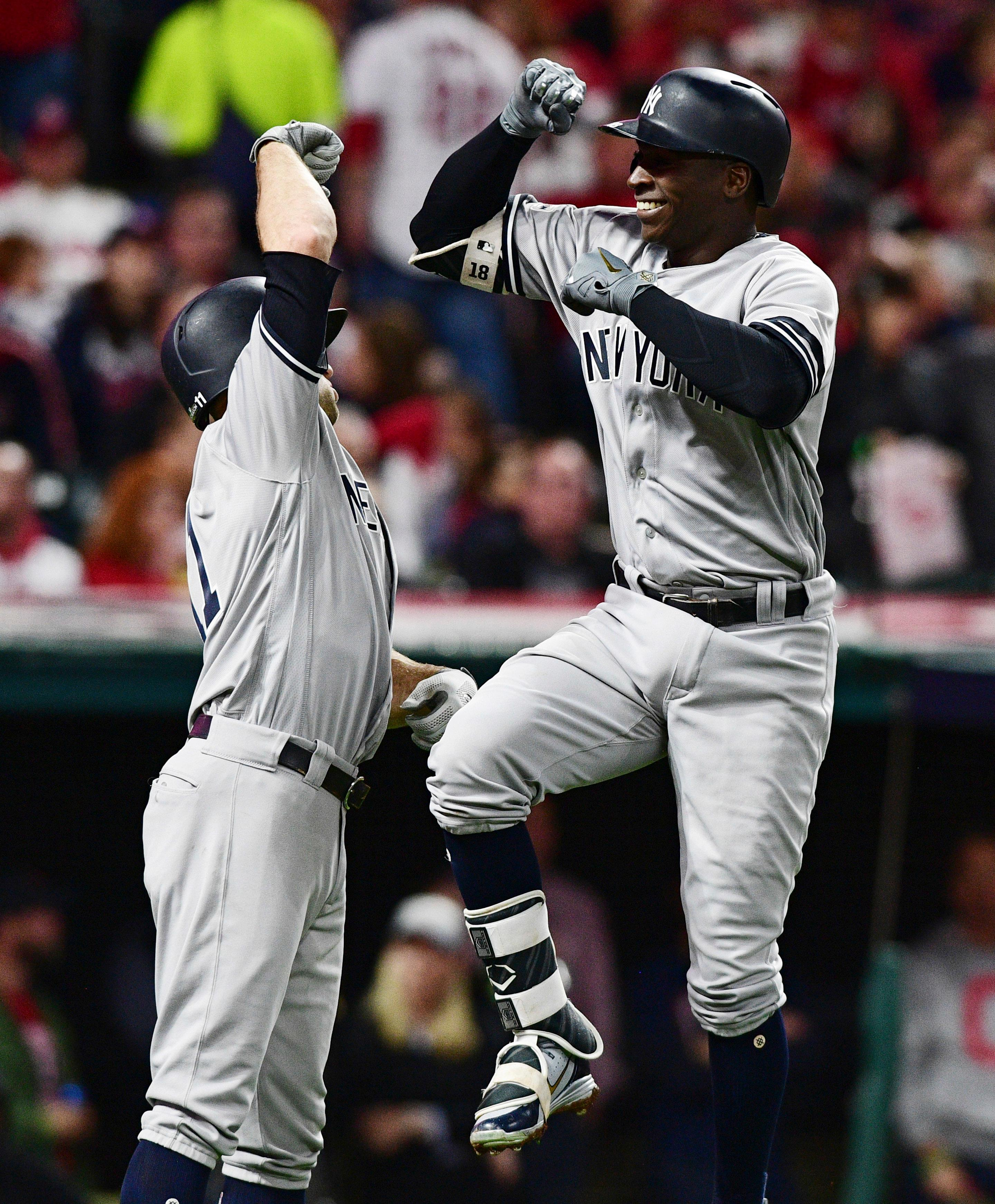 New York Yankees' Didi Gregorius, right, is congratulated by Brett Gardner after Gregorius hit a two-run home run off Cleveland Indians starting pitcher Corey Kluber during the third inning of Game 5 of a baseball American League Division Series, Wednesday, Oct. 11, 2017, in Cleveland. Gardner scored on the play. (AP Photo/David Dermer)