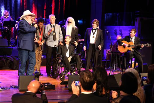 "From left, artists Charlie Daniels, Duane Allen, Charley Pride, Joe Bonsall, Randy Travis, William Lee Golden, and Richard Sterban sing ""Will the Circle Be Unbroken?"" at the close of the Country Music Hall of Fame Medallion Ceremony at the Country Music Hall of Fame and Museum on Sunday, October 16, 2016 in Nashville, Tenn. (Photo by Laura Roberts/Invision/AP)"